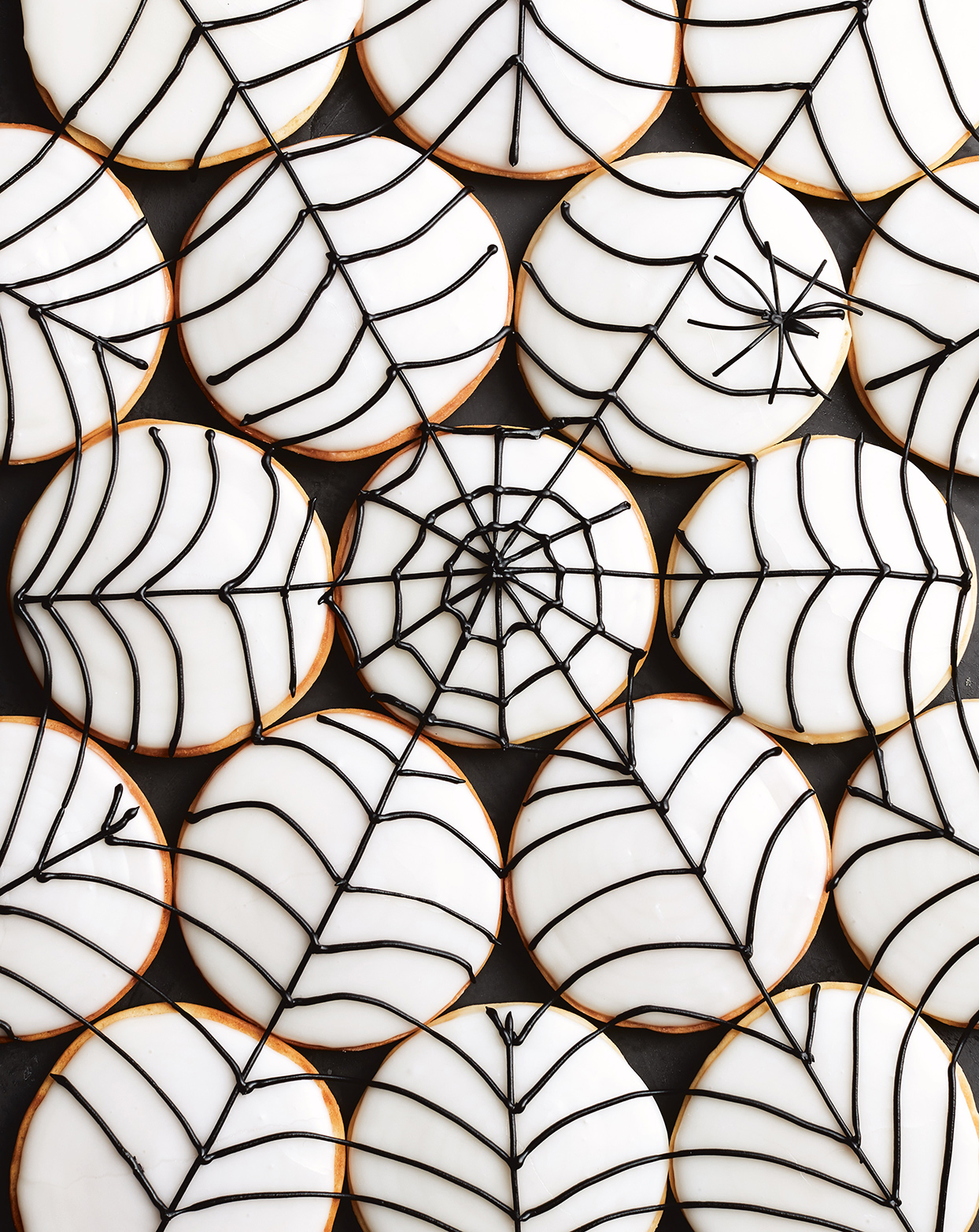 white and black spider web cookies