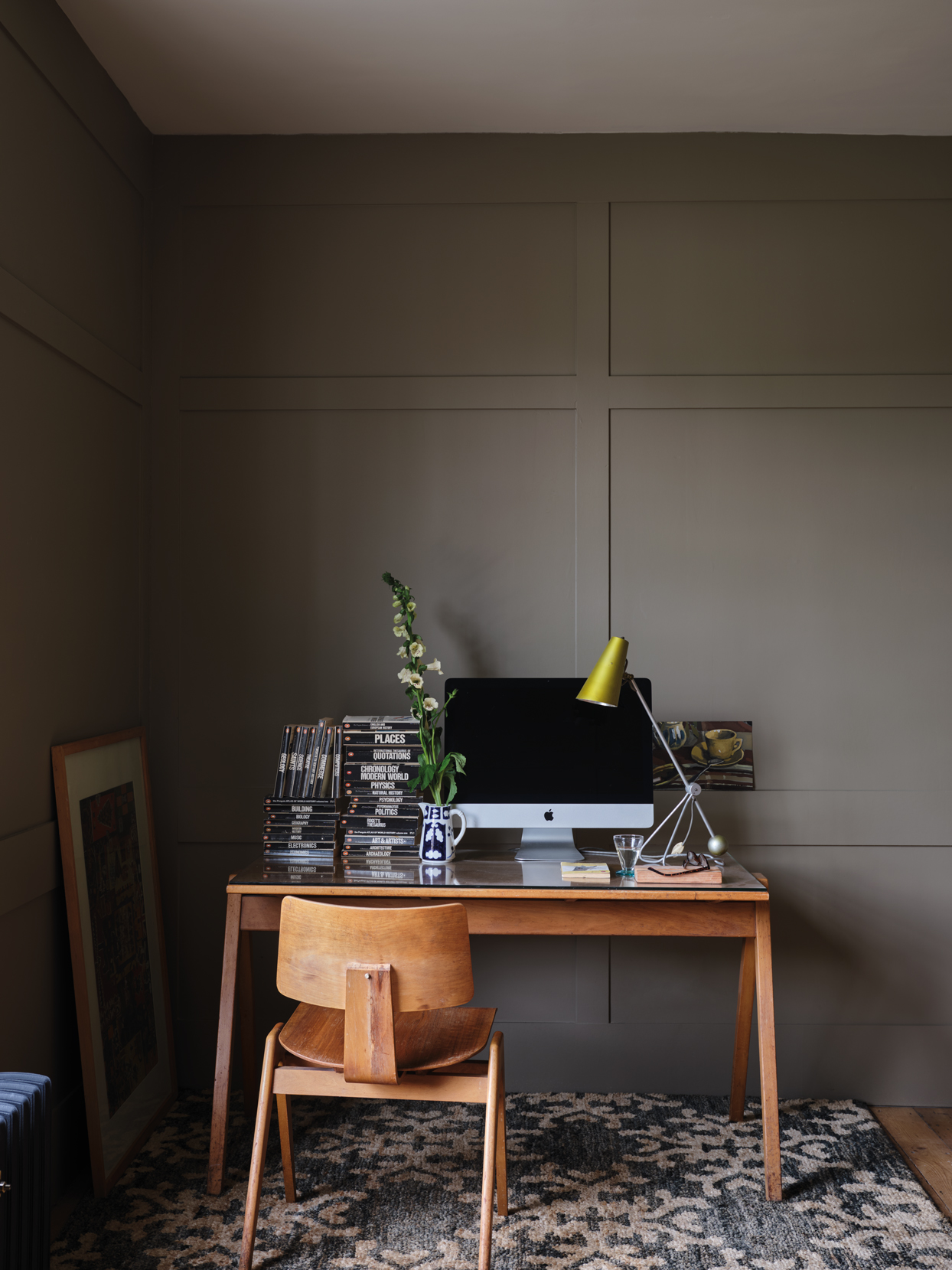 wooden desk in brown-painted at home office