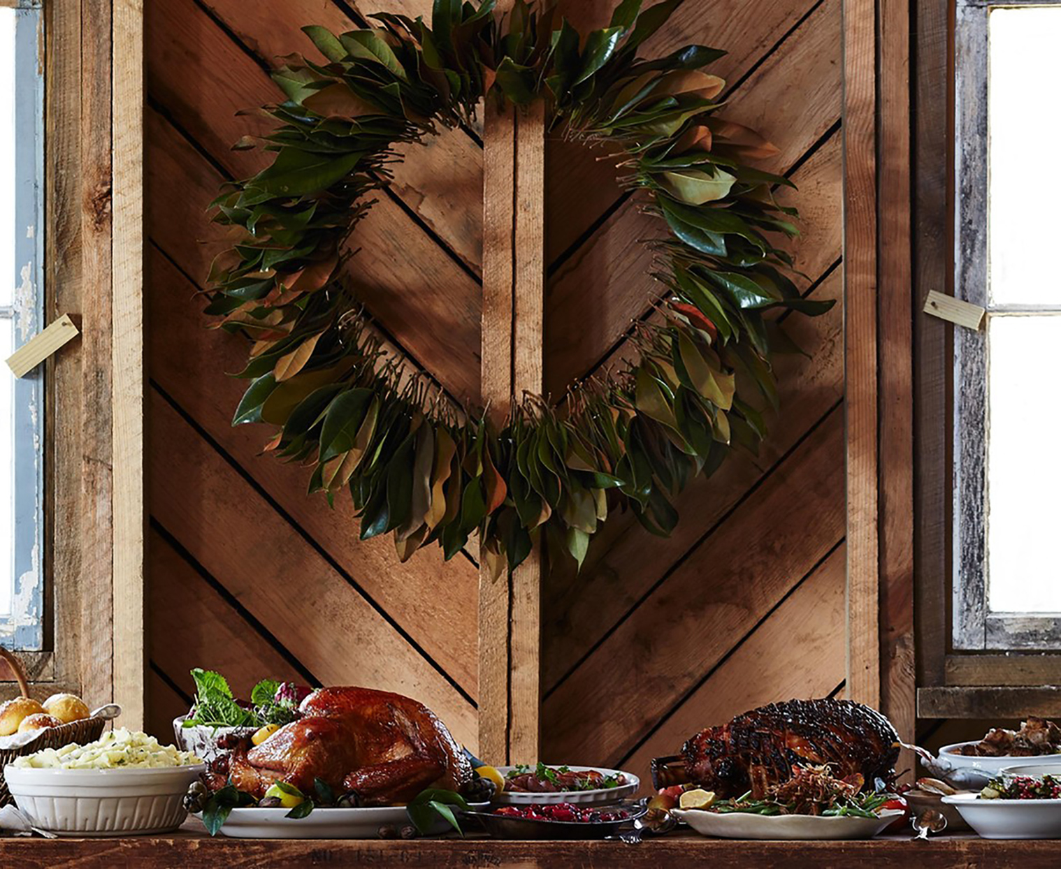 wreath hanging above table of food