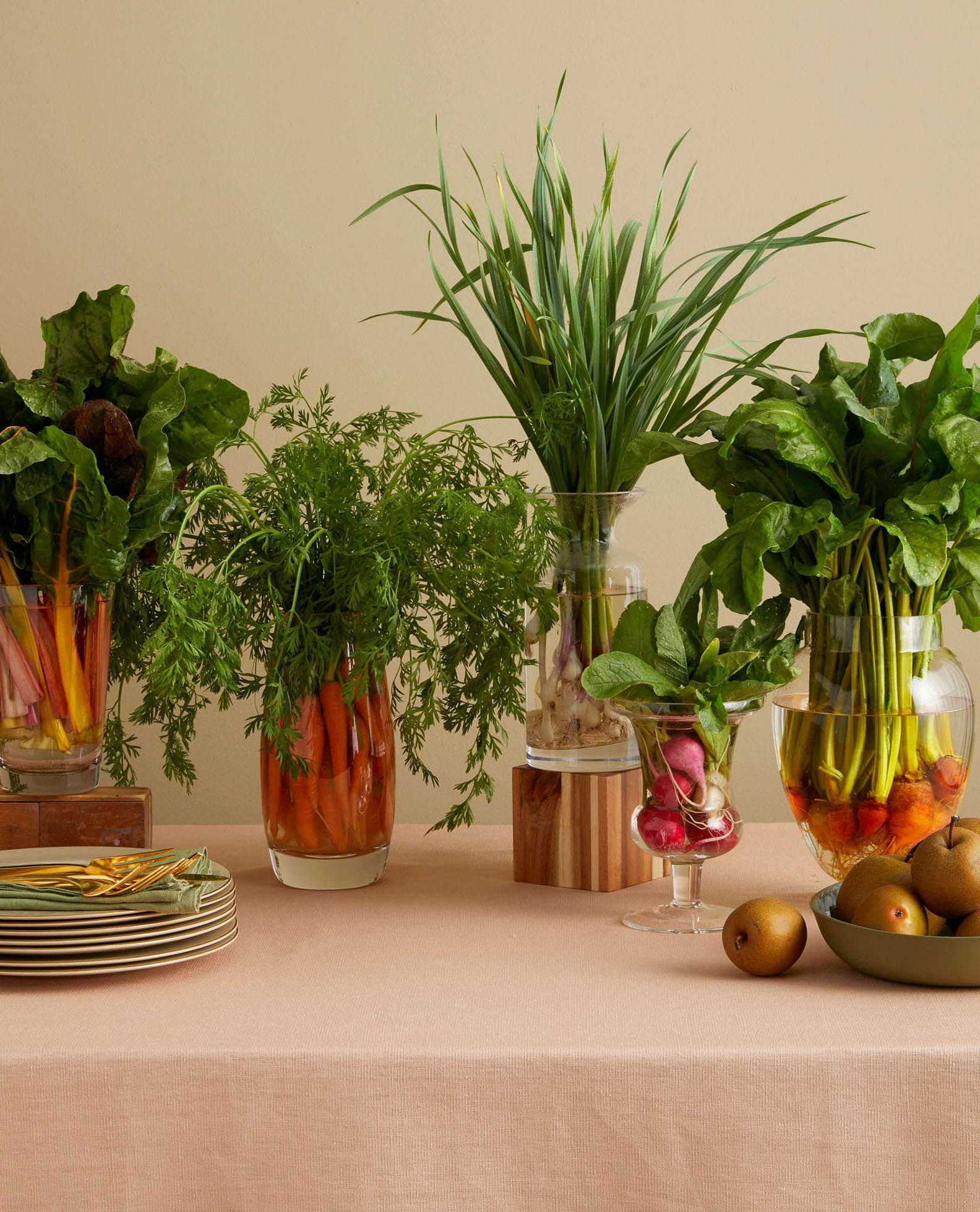 vegetables in clear vessels as a Thanksgiving autumnal centerpiece