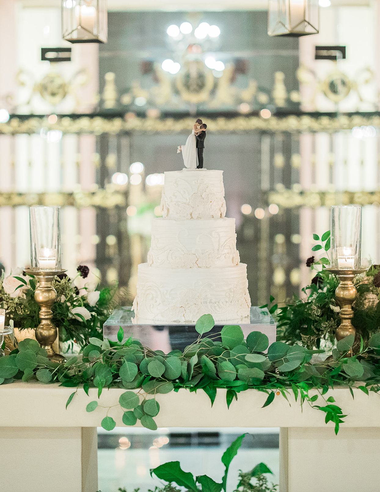 victoria tk wedding cake surrounded by greenery