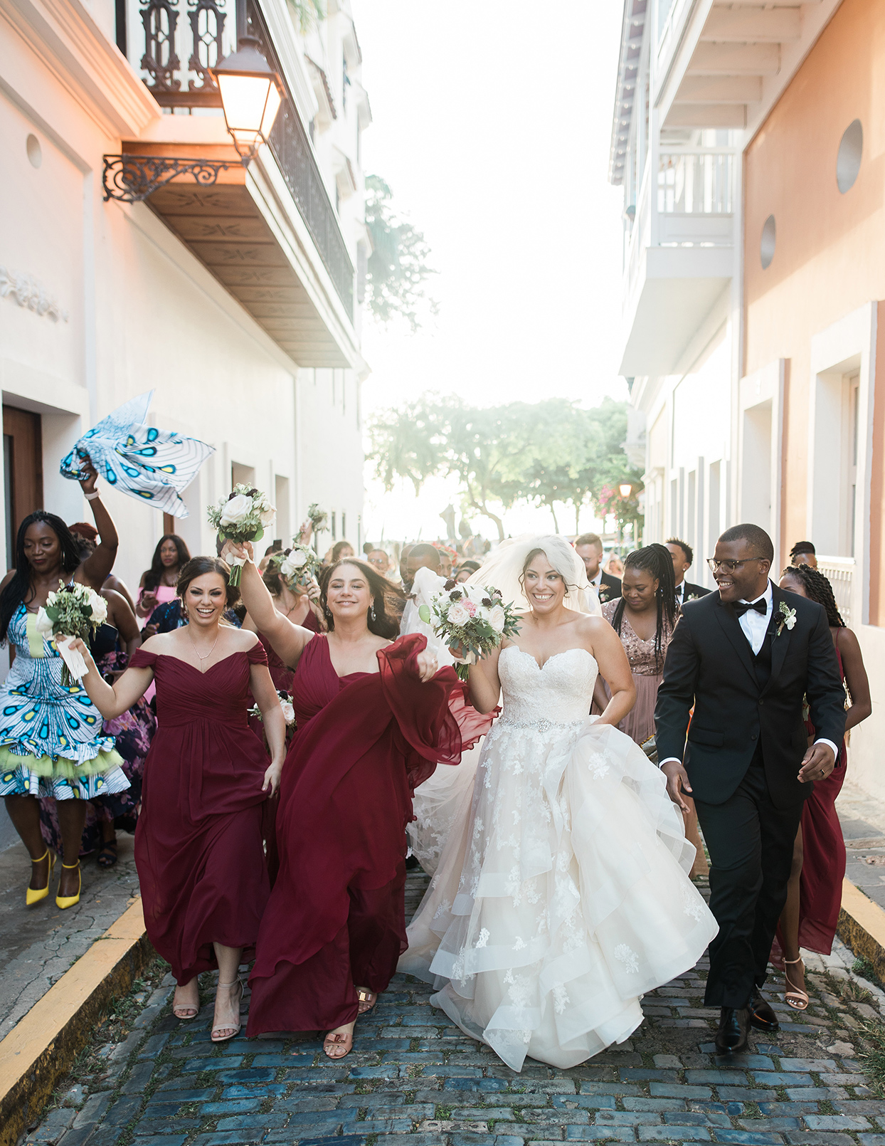 victoria tk wedding party walking down street