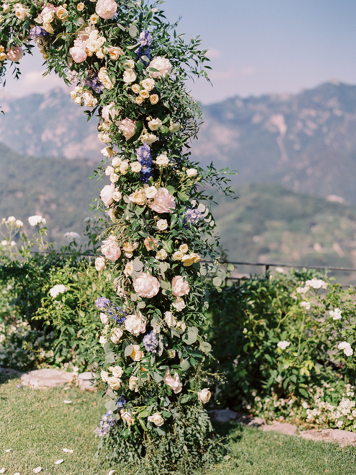 jacqueline david wedding ceremony floral arch overlooking mountains
