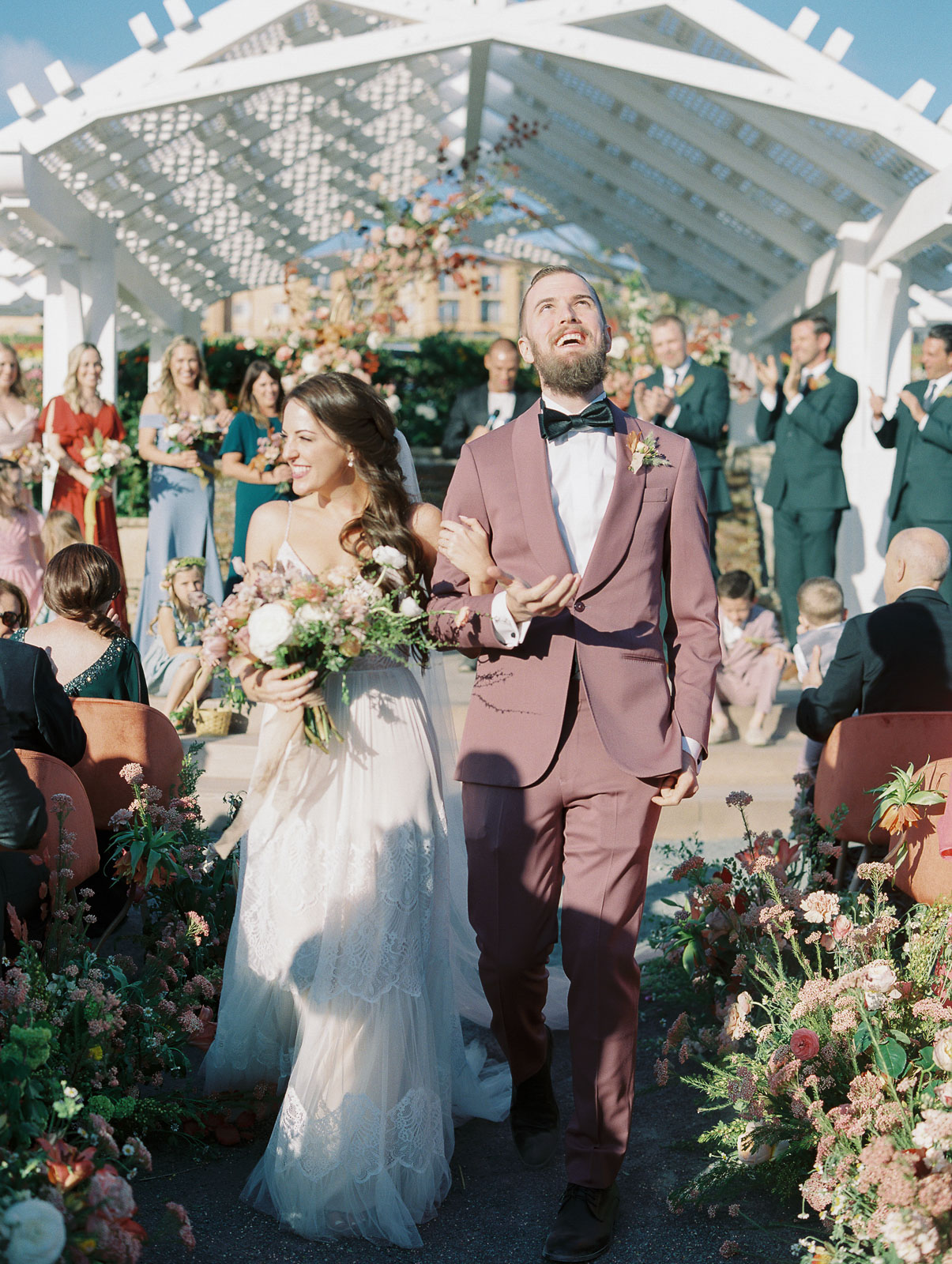 bride and groom recessional aisle smiling guests clapping