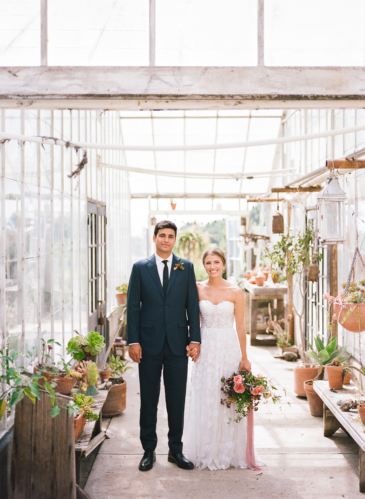 bride groom holding hands greenhouse entrance