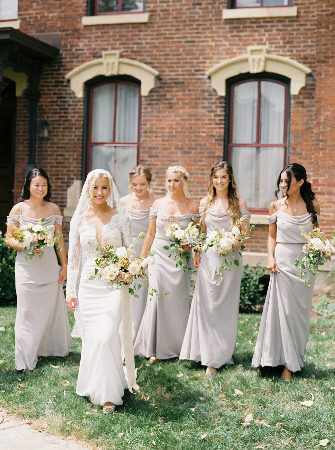 bride bridesmaids outdoors brick building