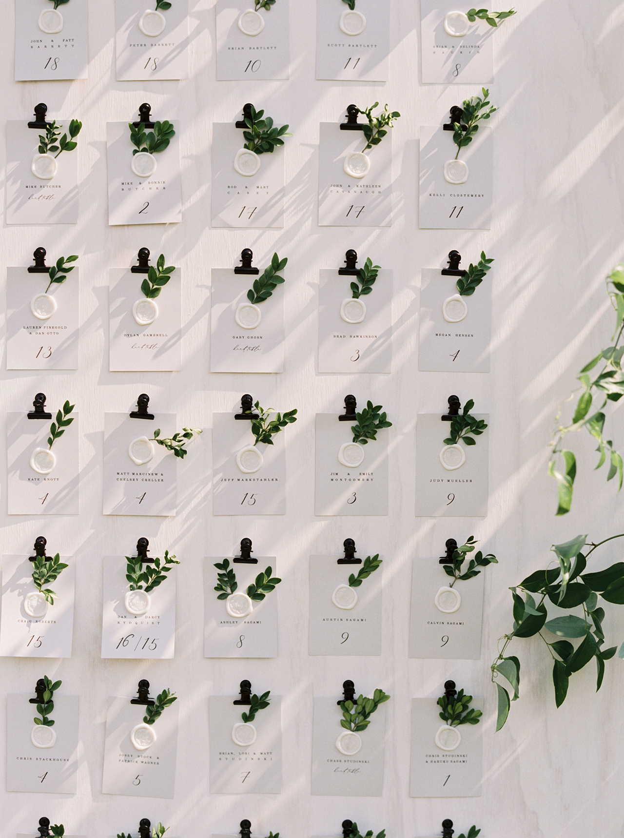 greenery sprig white wax seal escort card display