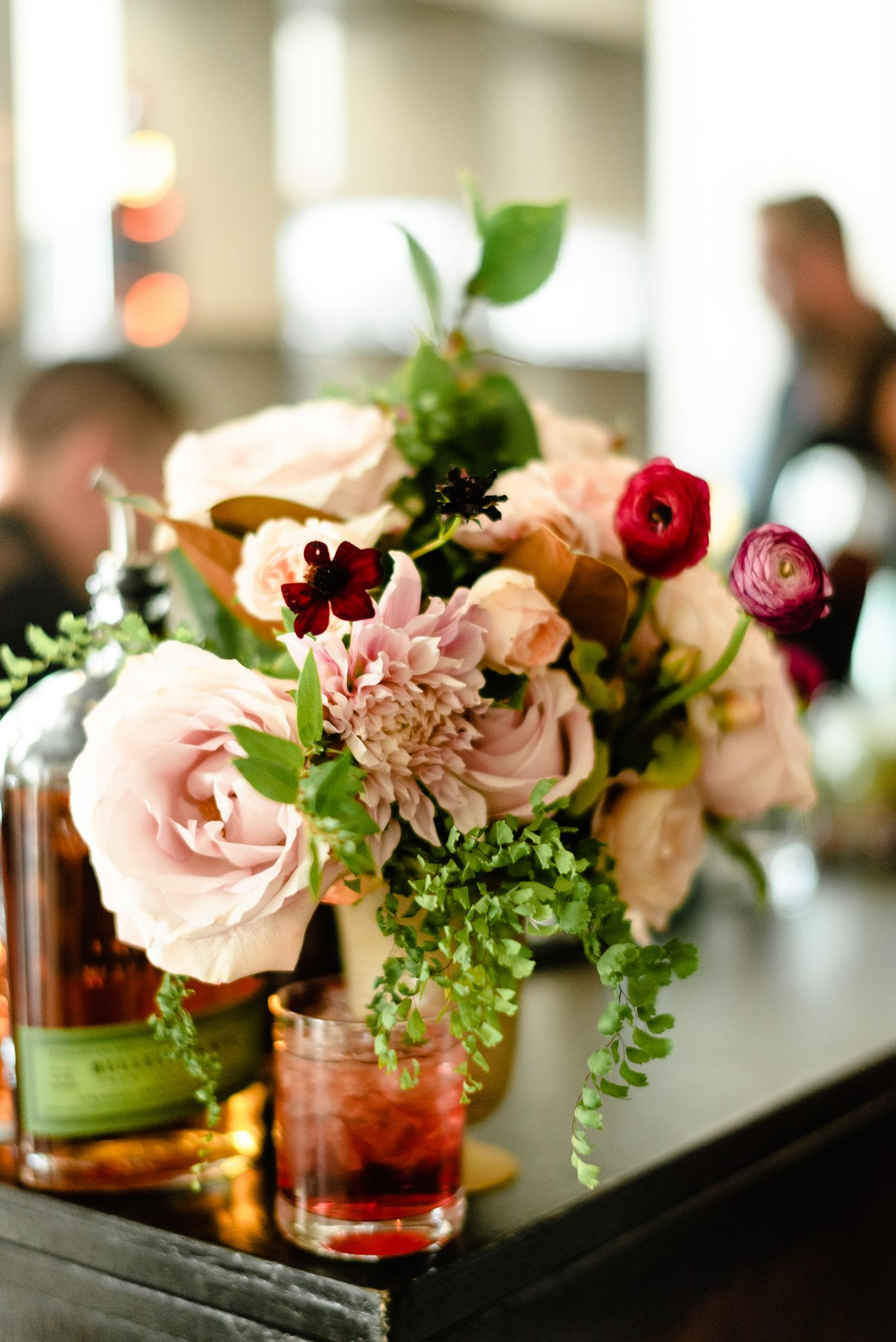 ryan shep wedding cocktails surrounded by floral decor