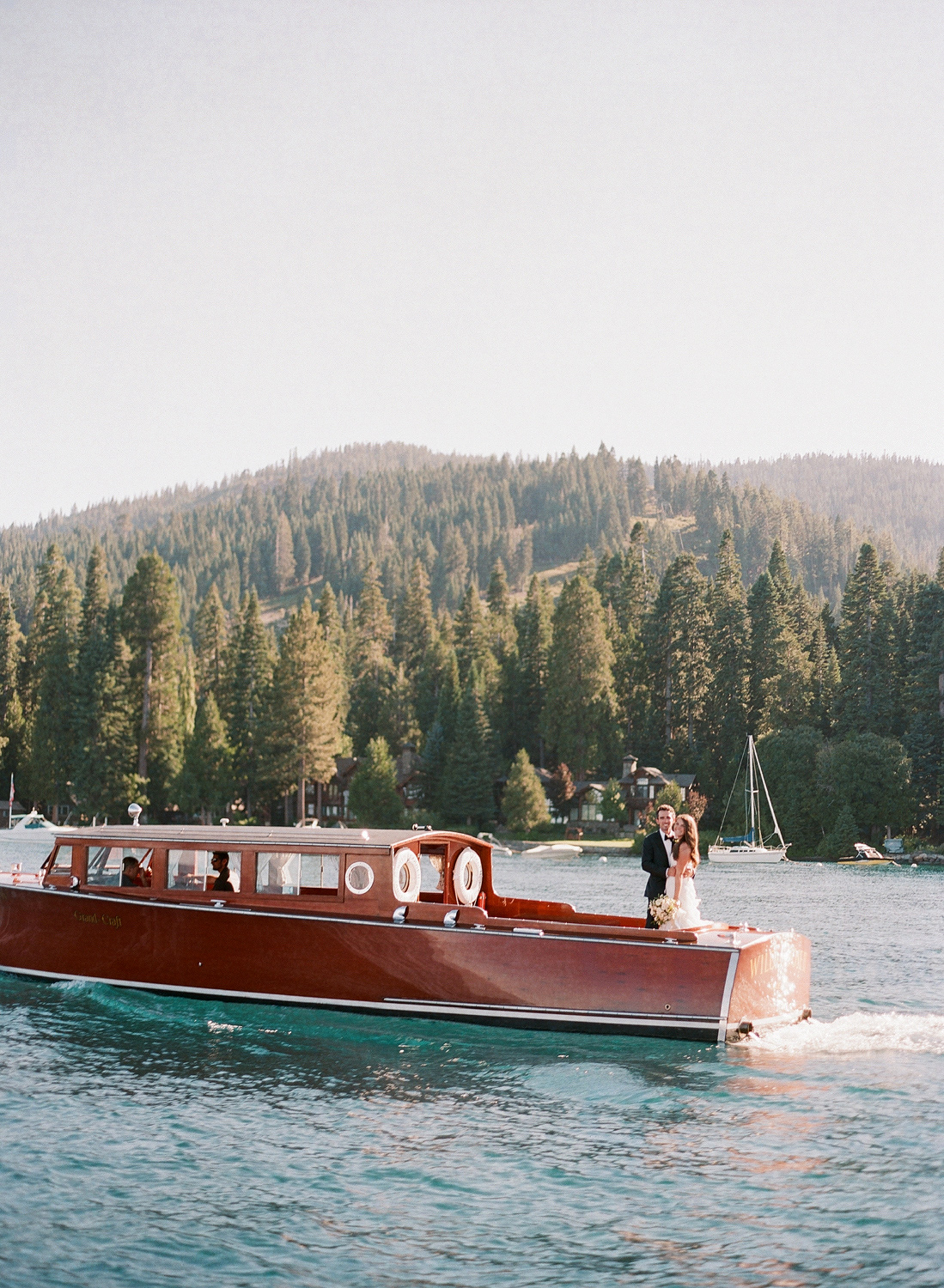 Natalie and Grant wedding bride and groom portrait on red boat