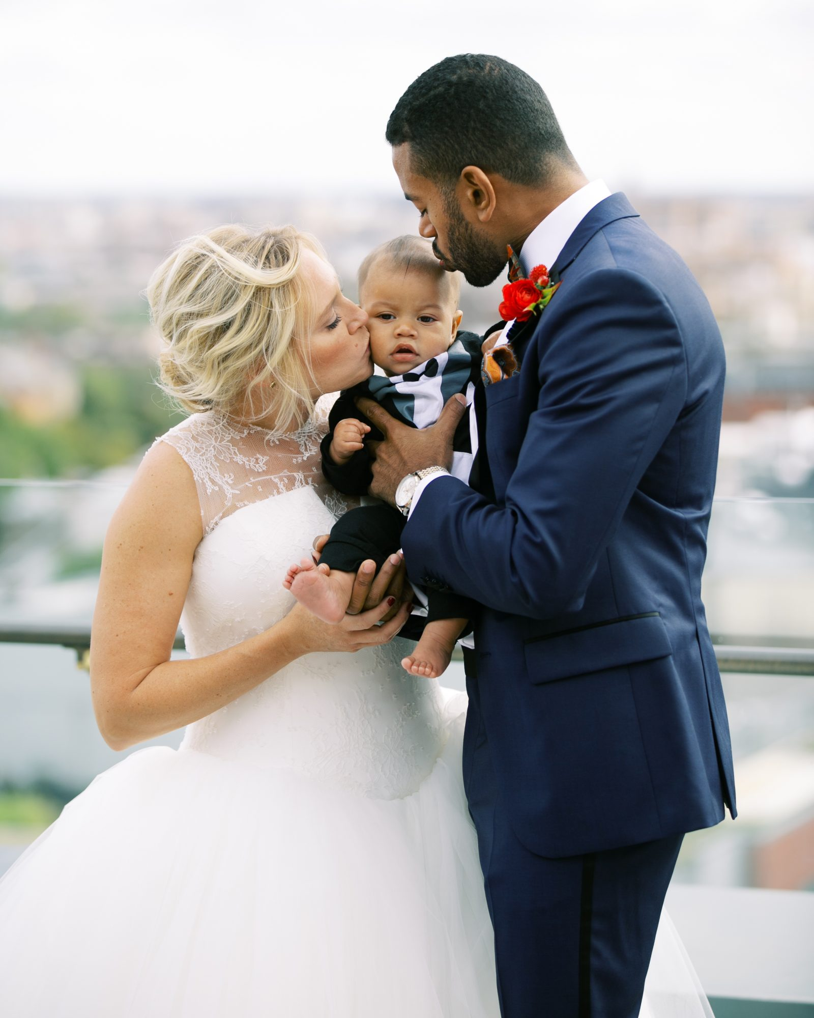 meaghan and david bride and groom with baby