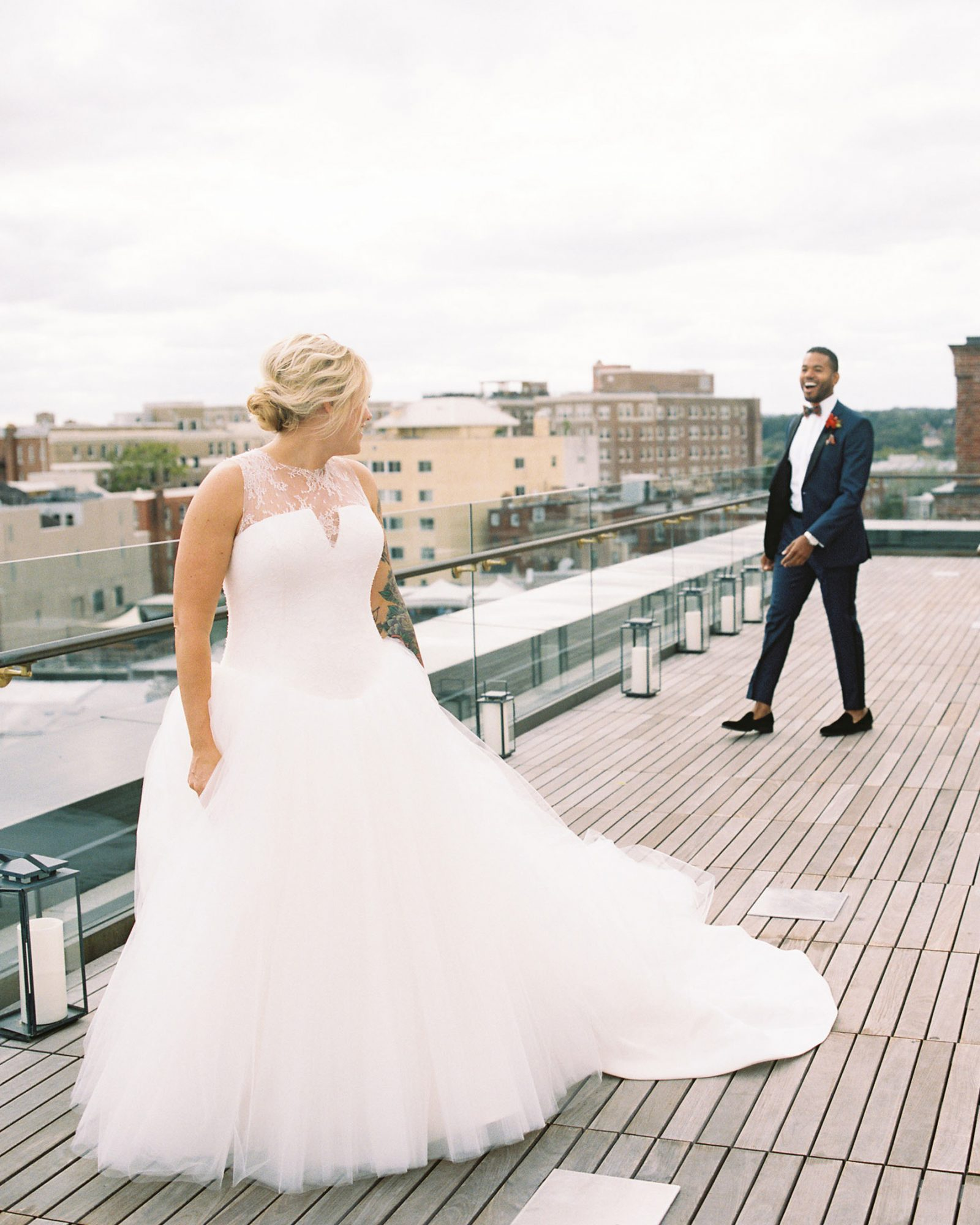 meaghan and david first look on rooftop