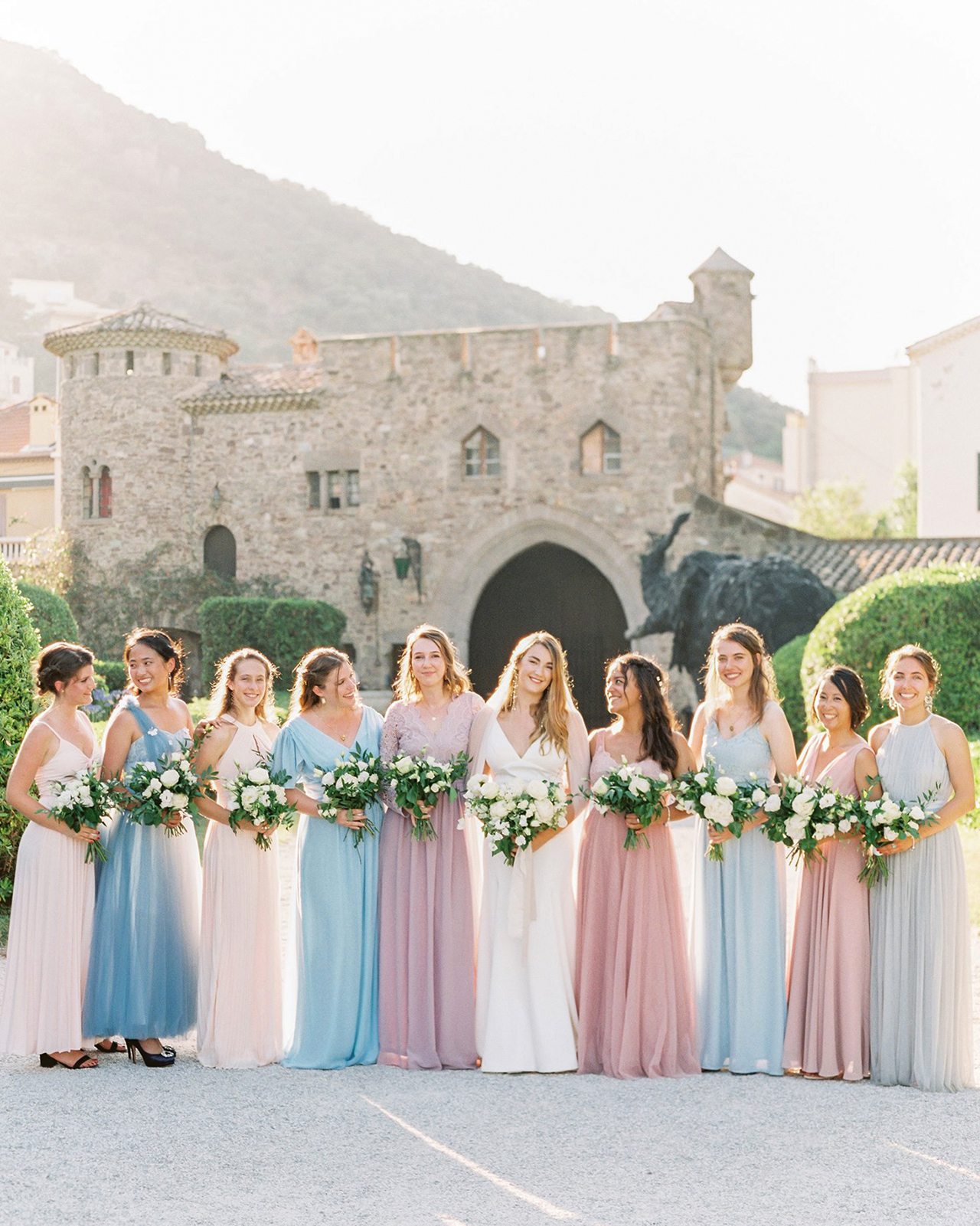 bride bridesmaids pose outdoors wedding gowns