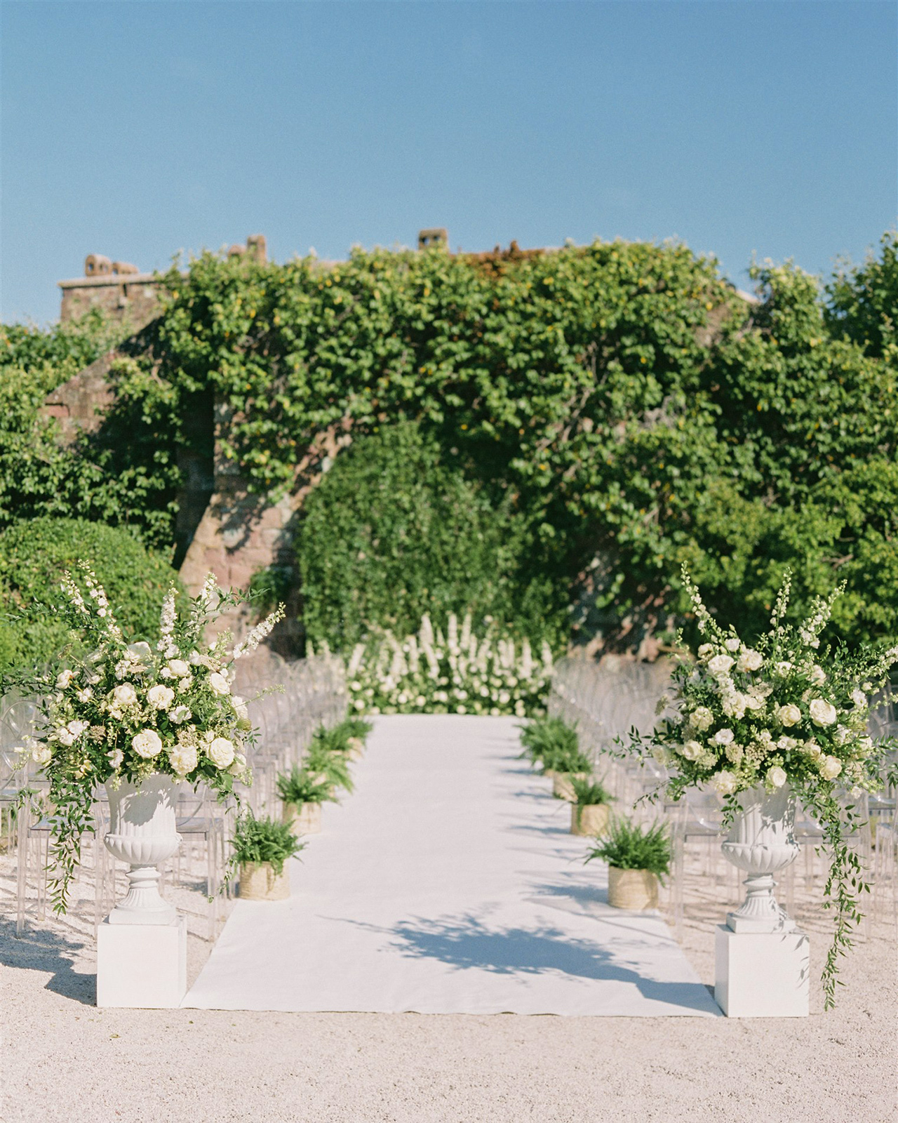 outdoor wedding ceremony space white floral arrangements
