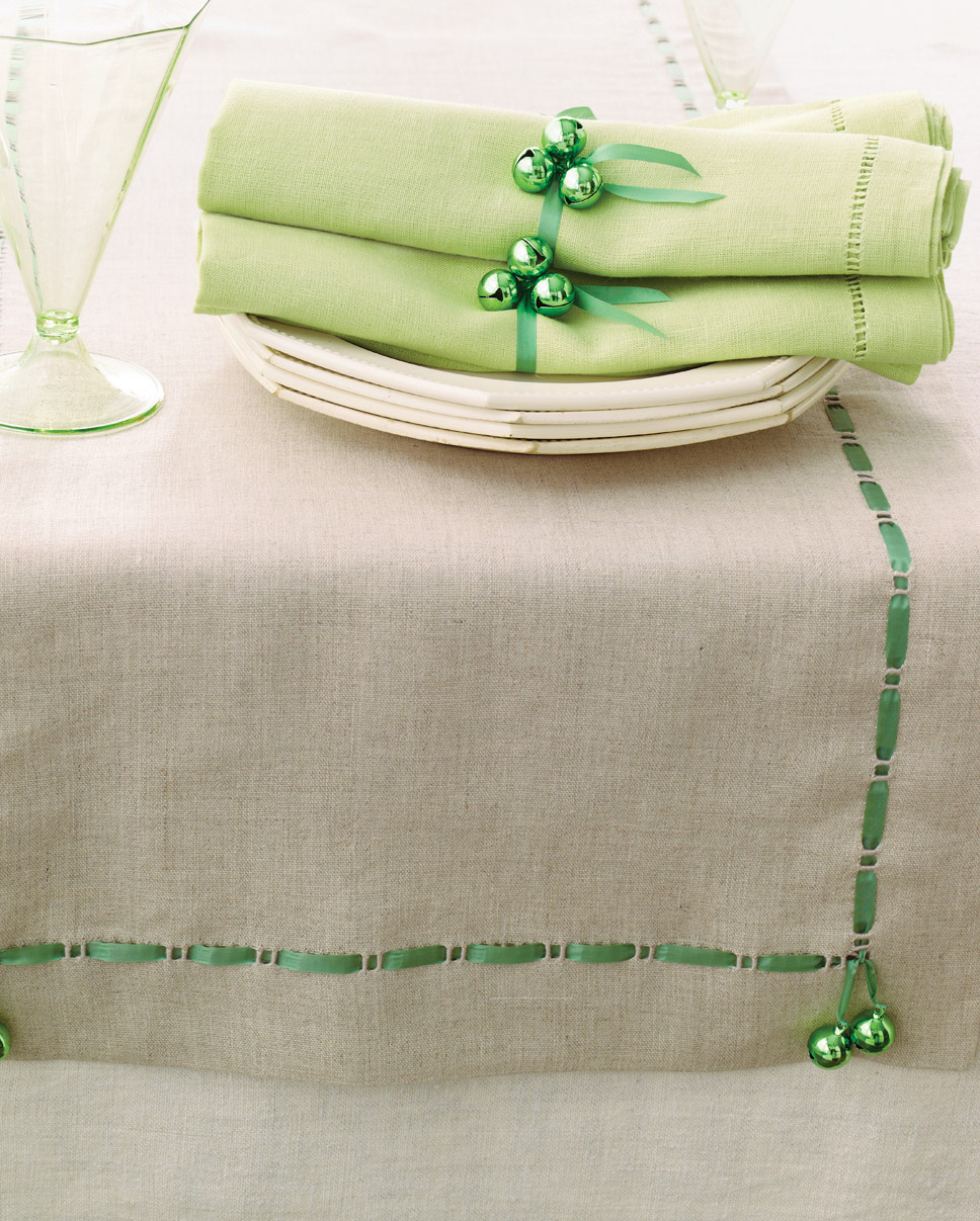 bells on a table runner and napkins for Christmas