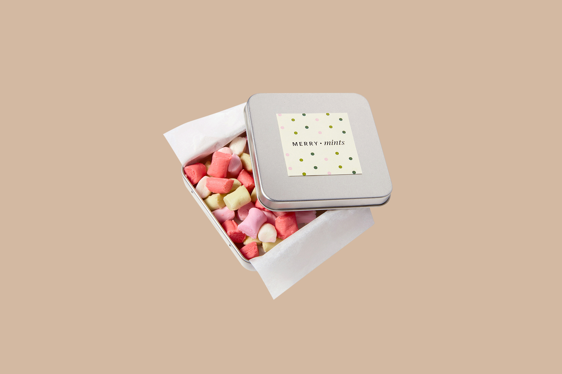 red, pink, and yellow butter mints in tin box