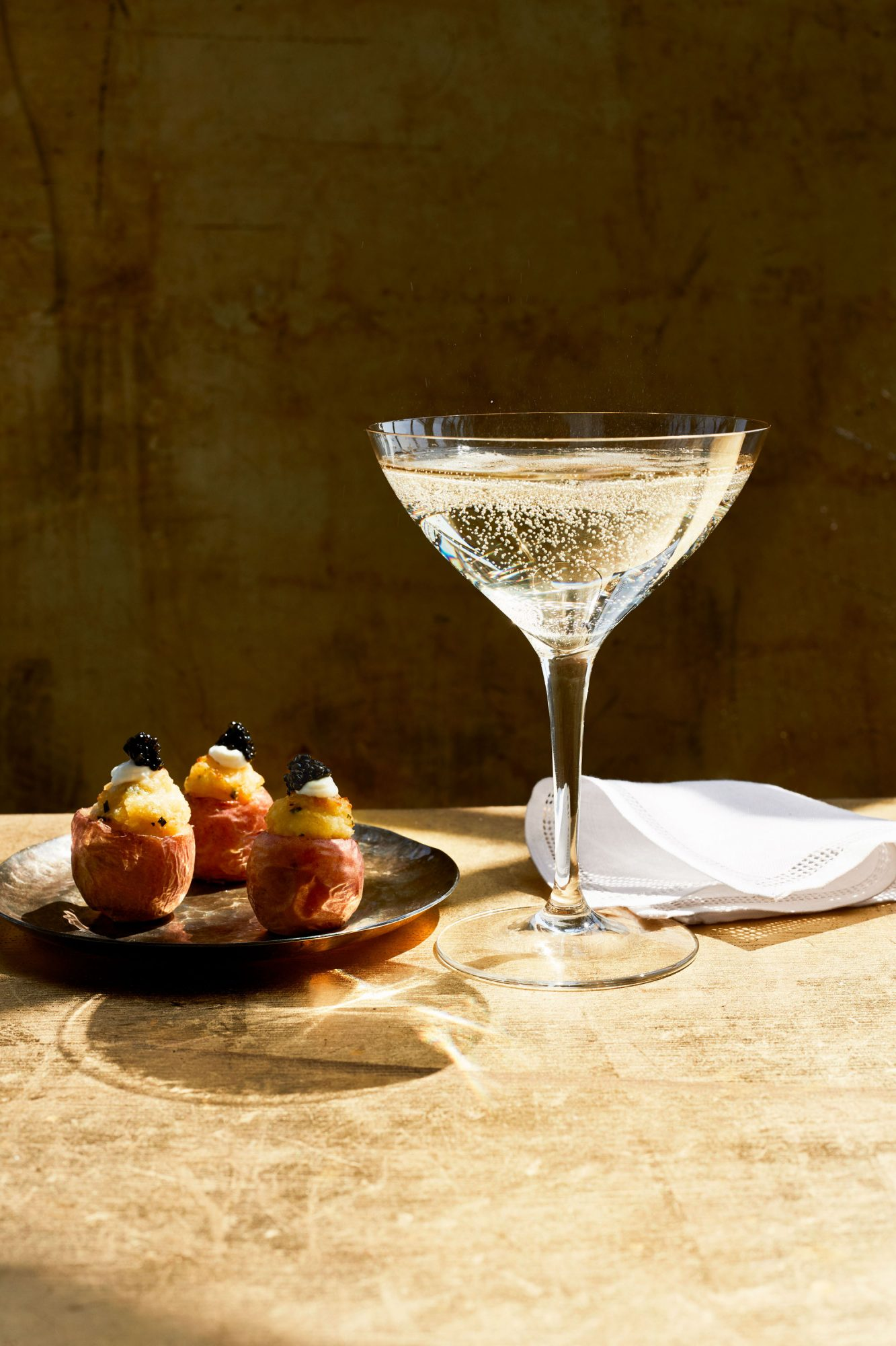 champagne and potatoes on table cloth