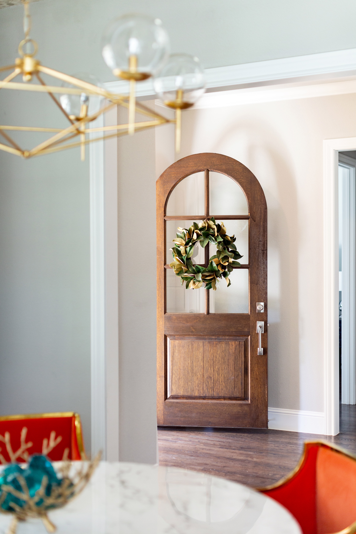 entryway with arched wooden front door