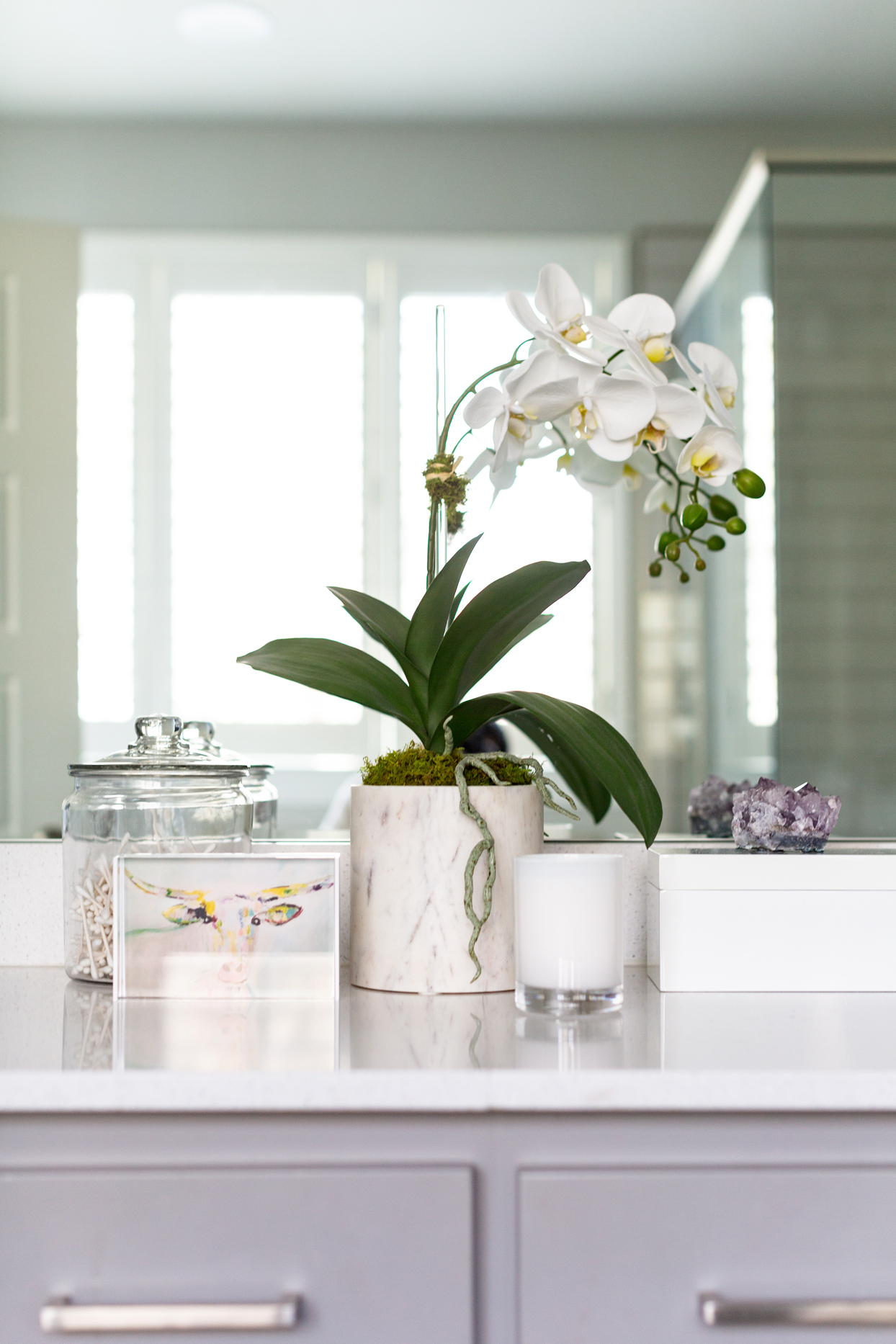 white orchid and amethyst master suite details