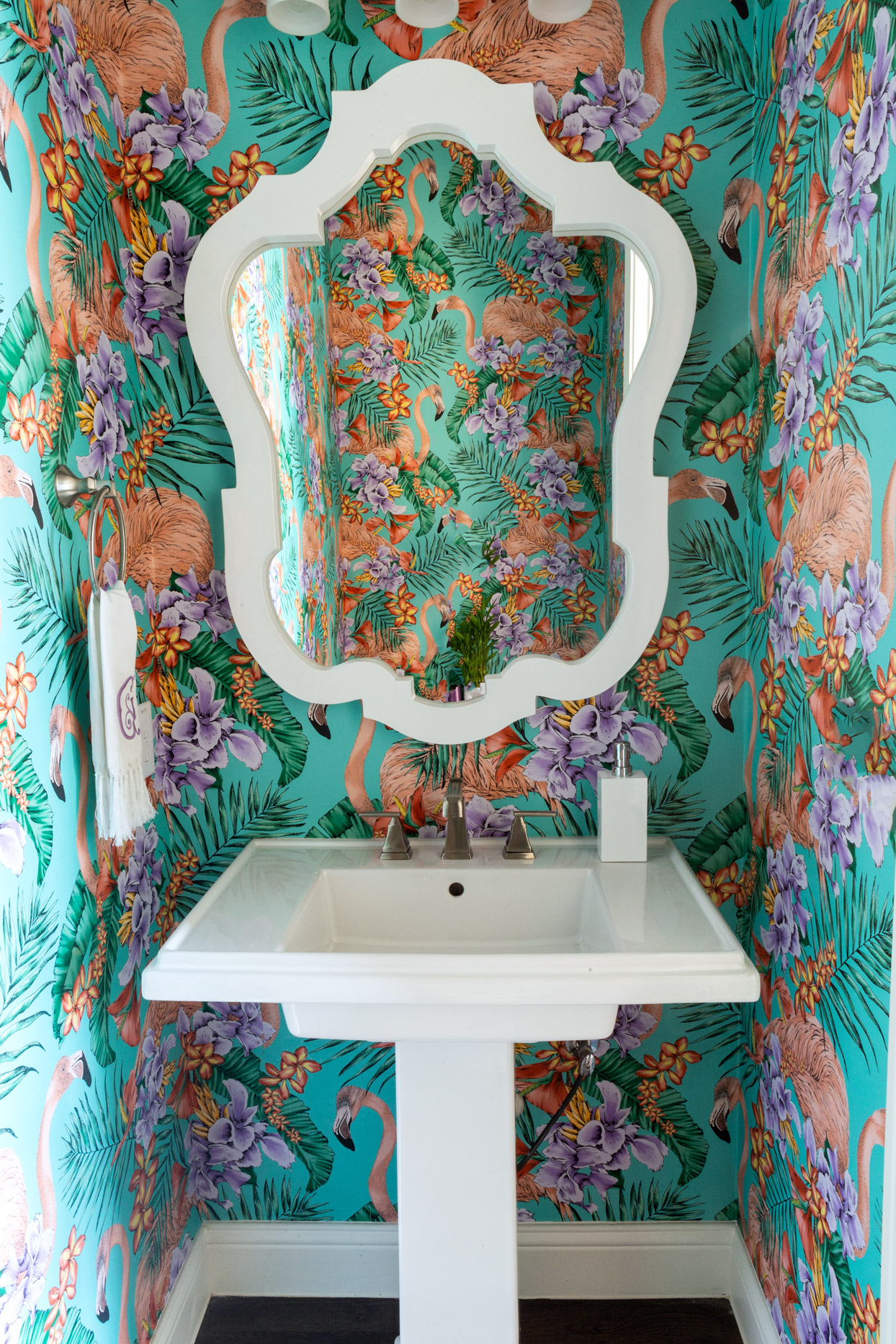 powder room with flamingo-patterned wallpaper