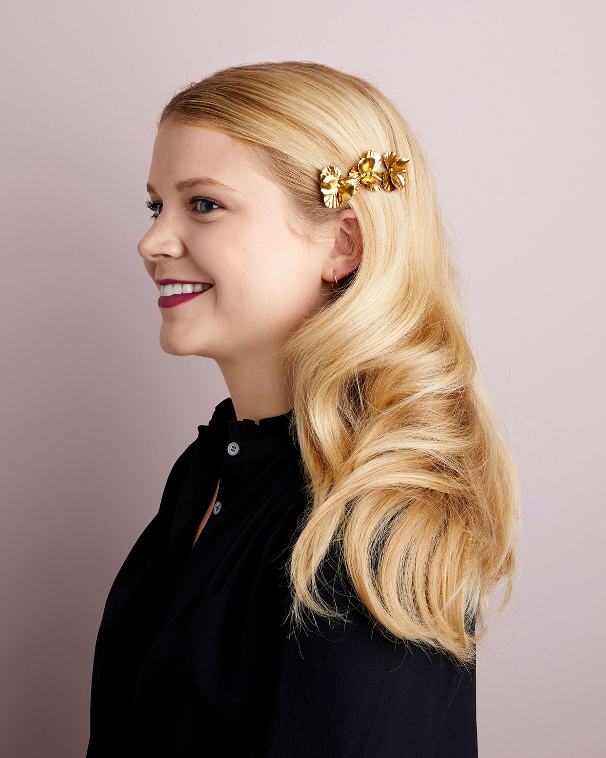 blond haired woman wearing gold barrette
