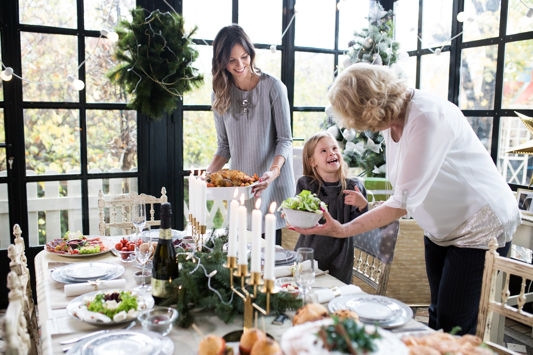 family placing food table with holiday decor