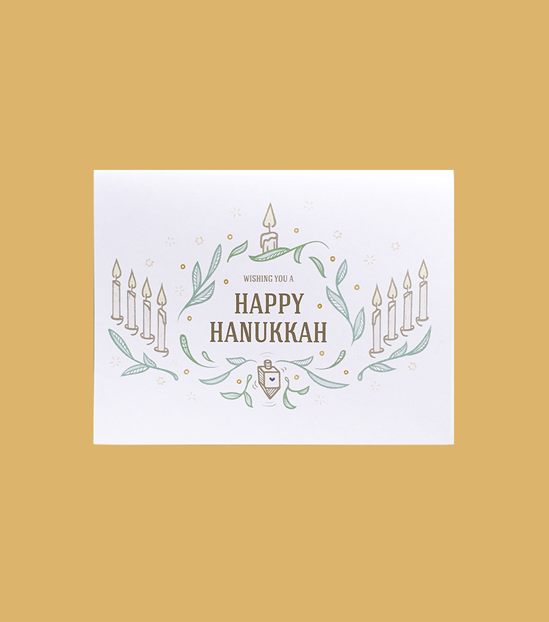 white Happy Hanukkah card with candle leaves illustration