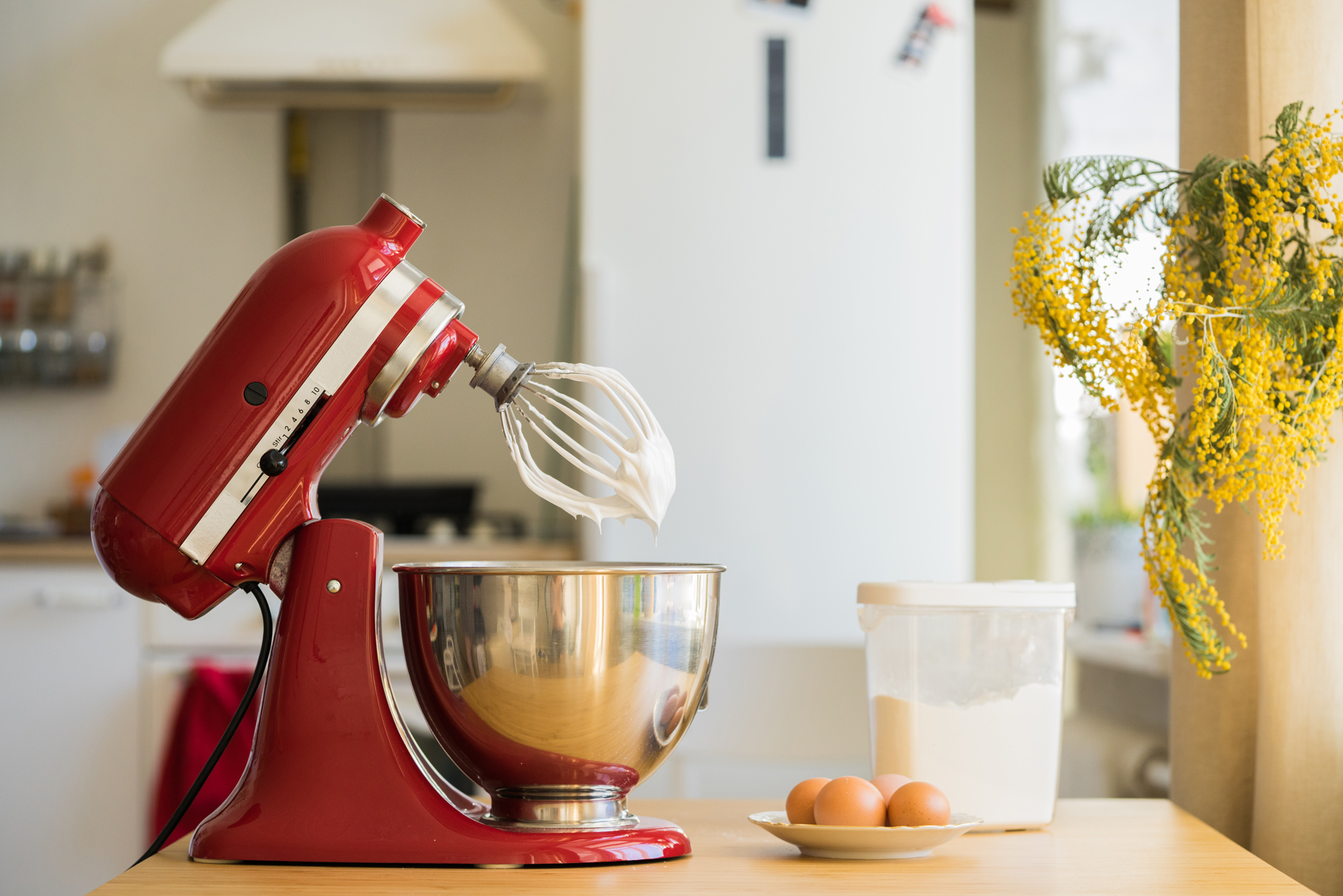 red kitchen air stand mixer on counter