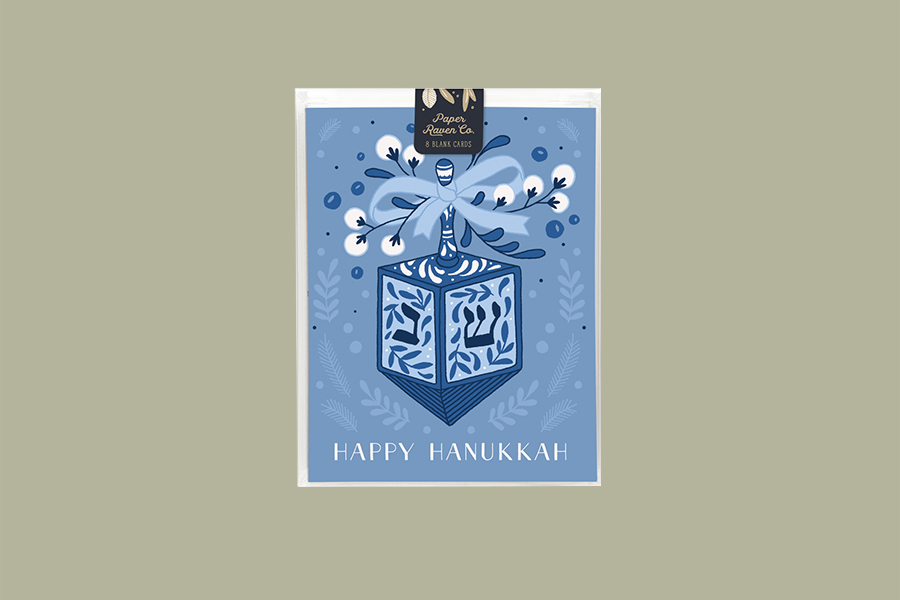 blue Happy Hannukkah card with blue and white dradle illustration