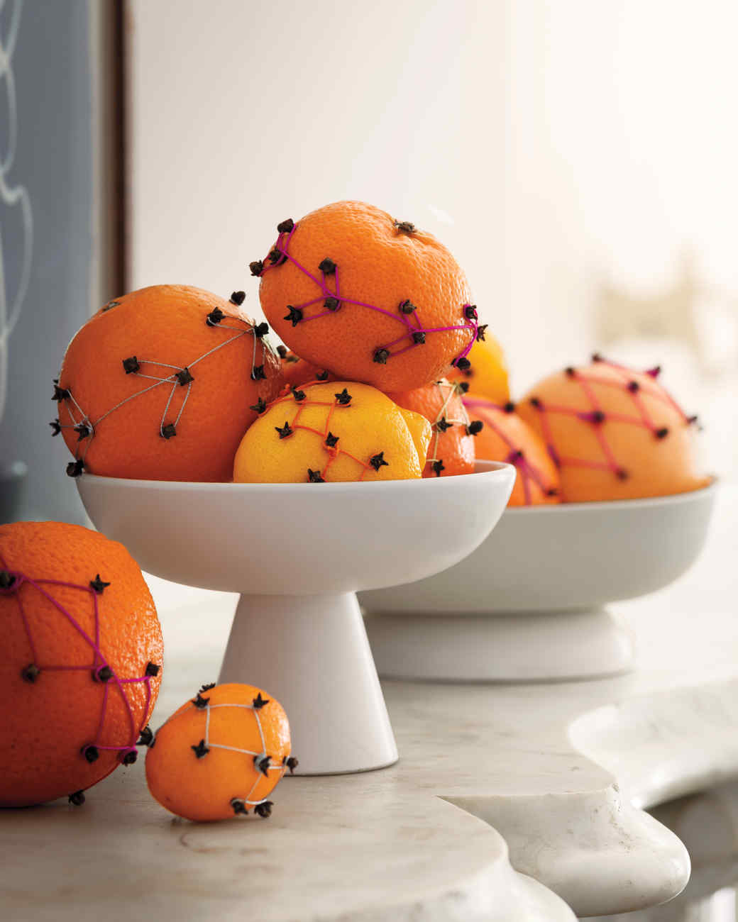 pomanders with neon thread and cloves