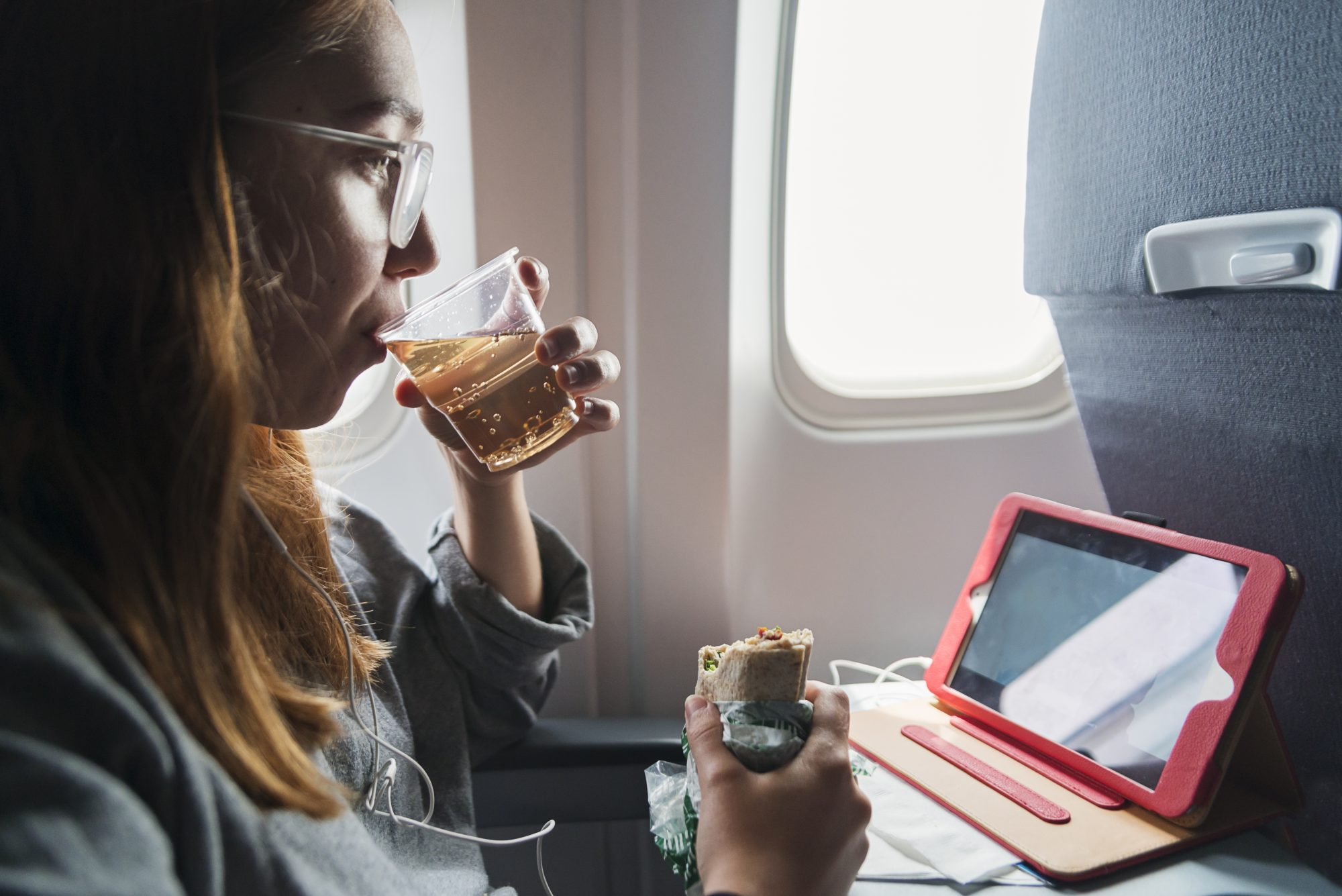 Woman on plane having a meal