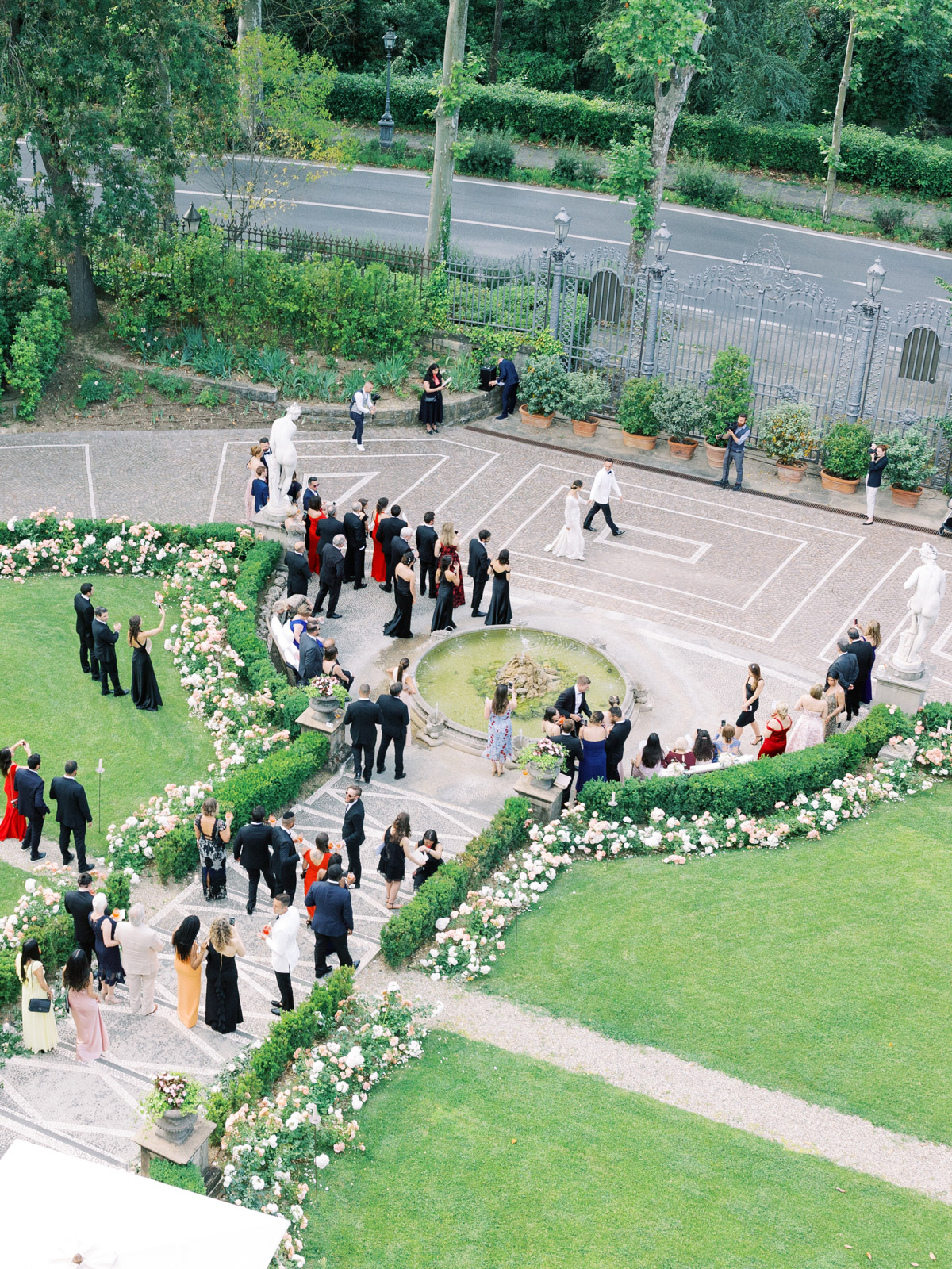 saghar ben wedding guests in courtyard from above