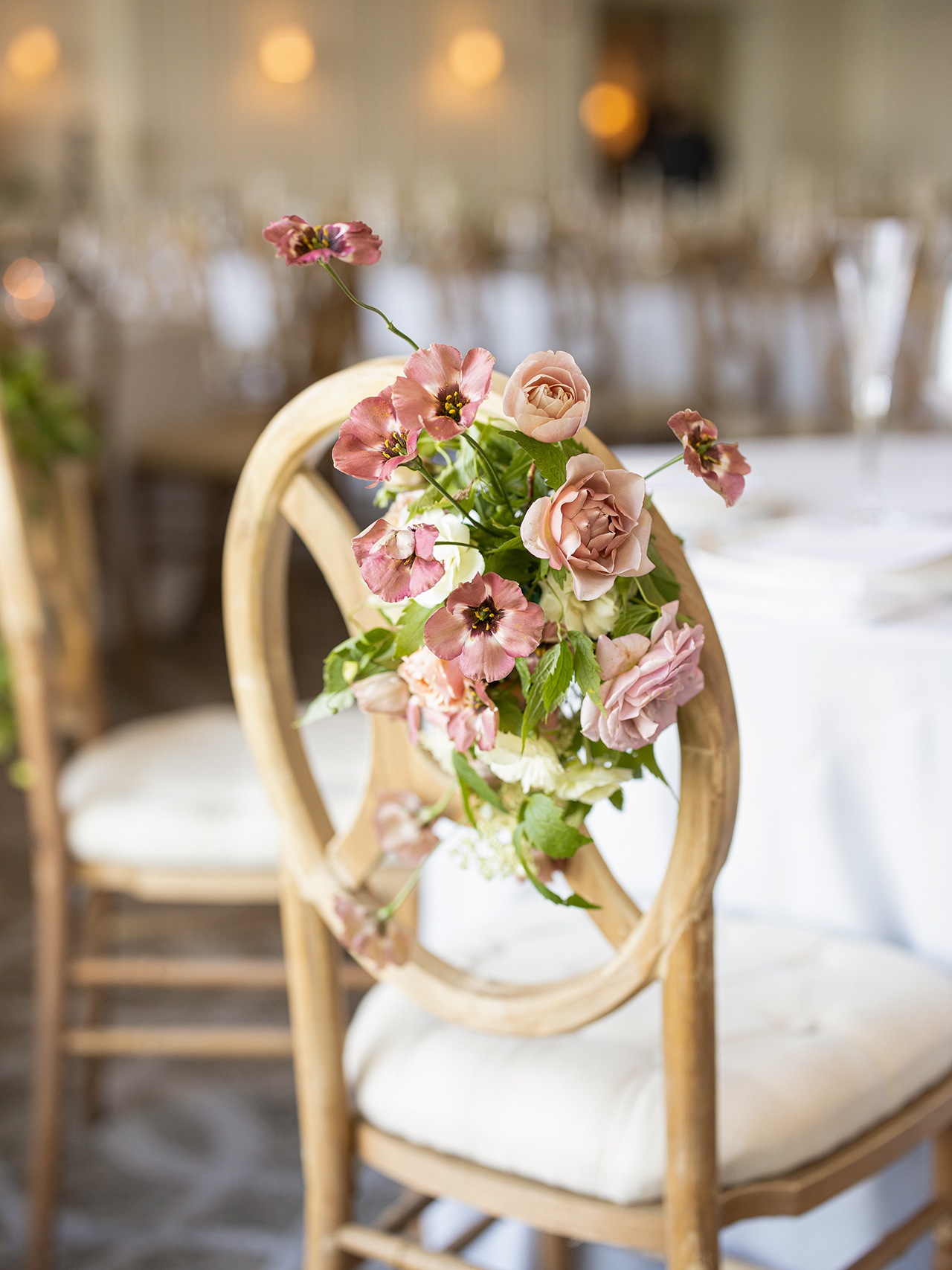 woven floral arrangement reception chairs