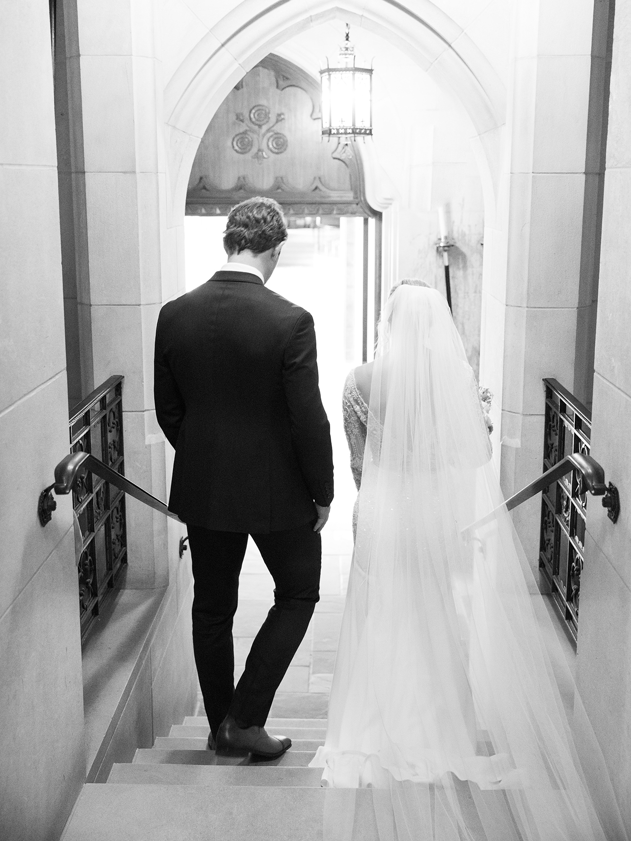 bride groom walking down steps of church