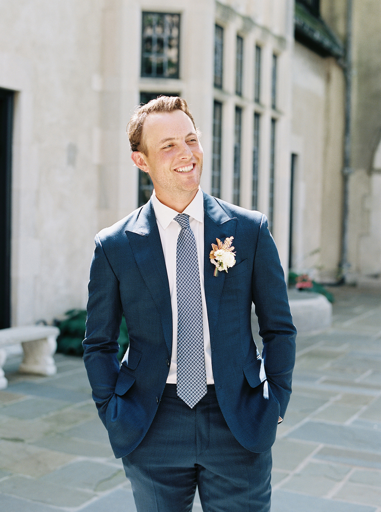 groom smiling custom blue suit