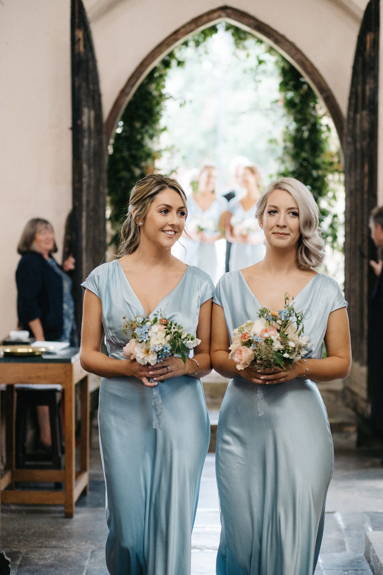 laurie lee wedding bridesmaids in blue attire with floral bouquets