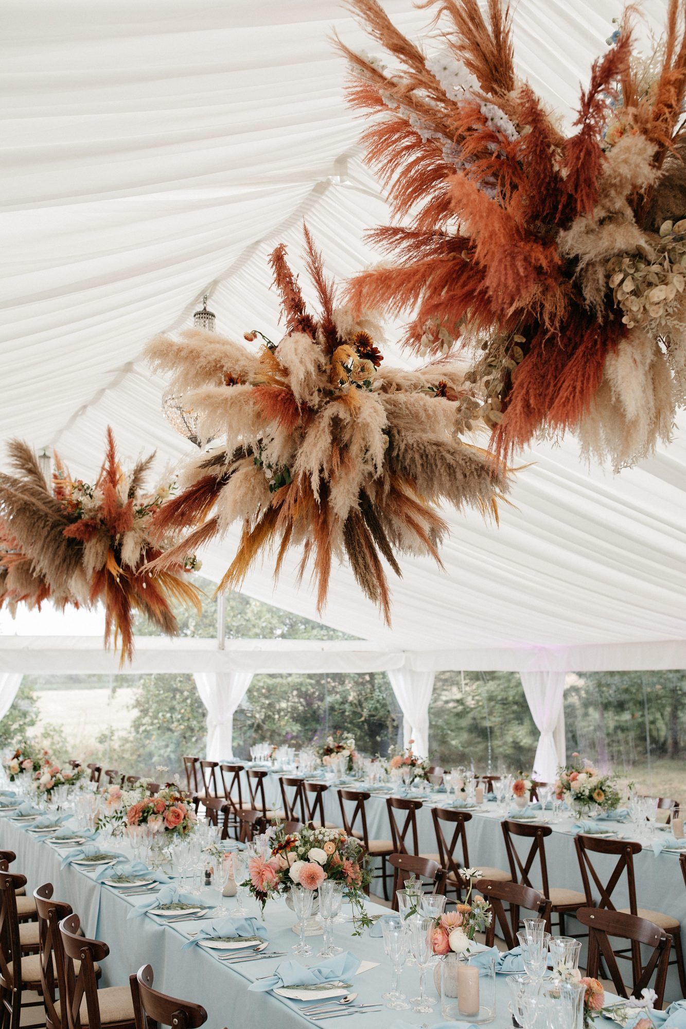 laurie lee wedding reception floral ceiling and table decor