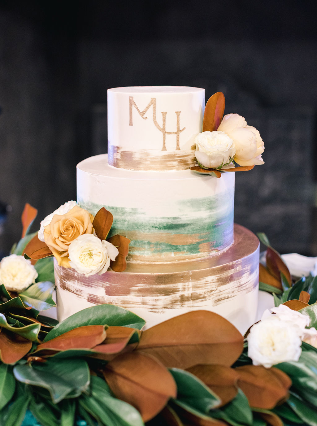 megan henock wedding reception earth tones cake