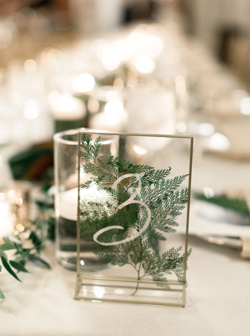 megan henock wedding reception greenery table numbers