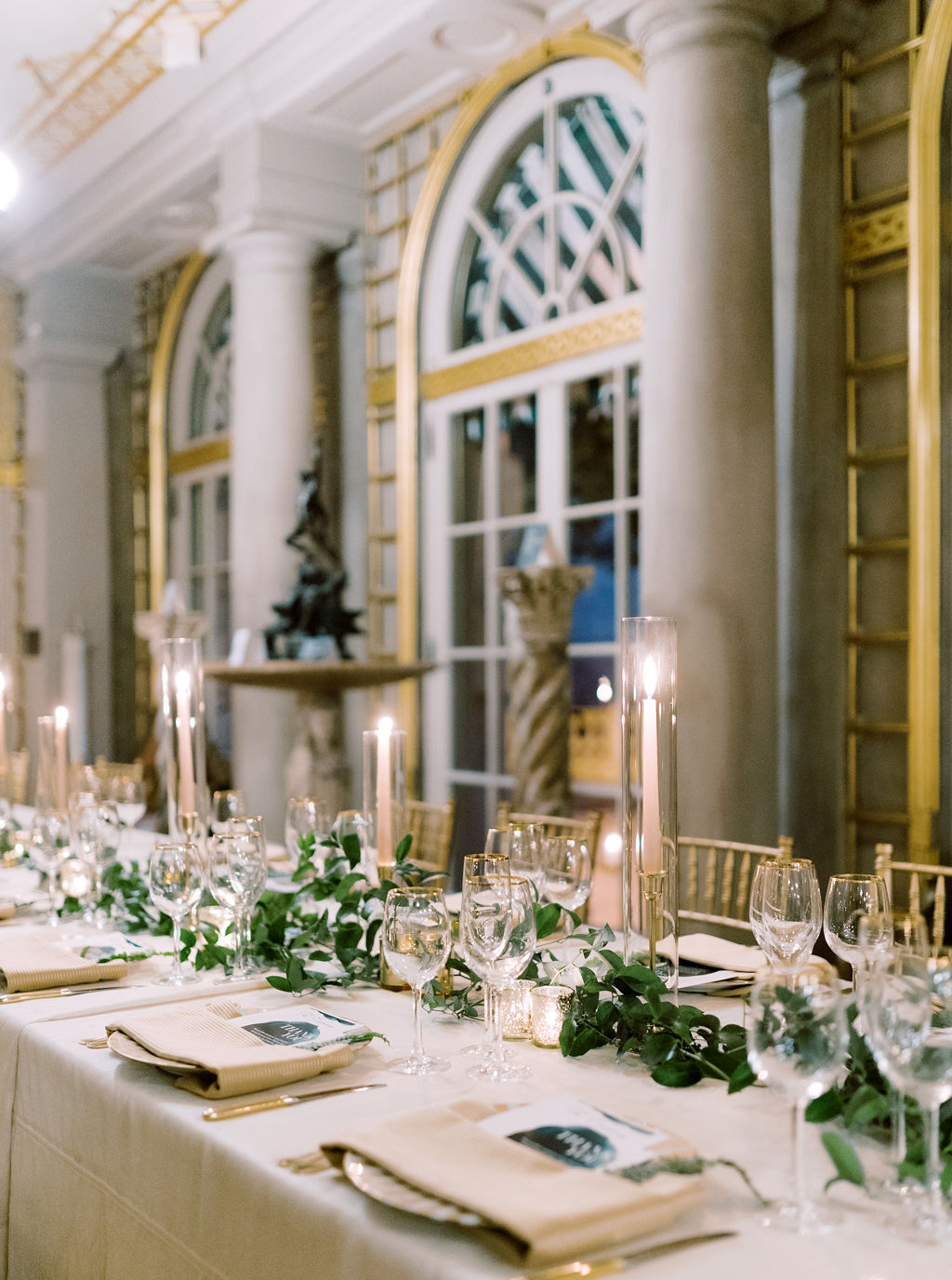 megan henock wedding reception golden and greenery table decor