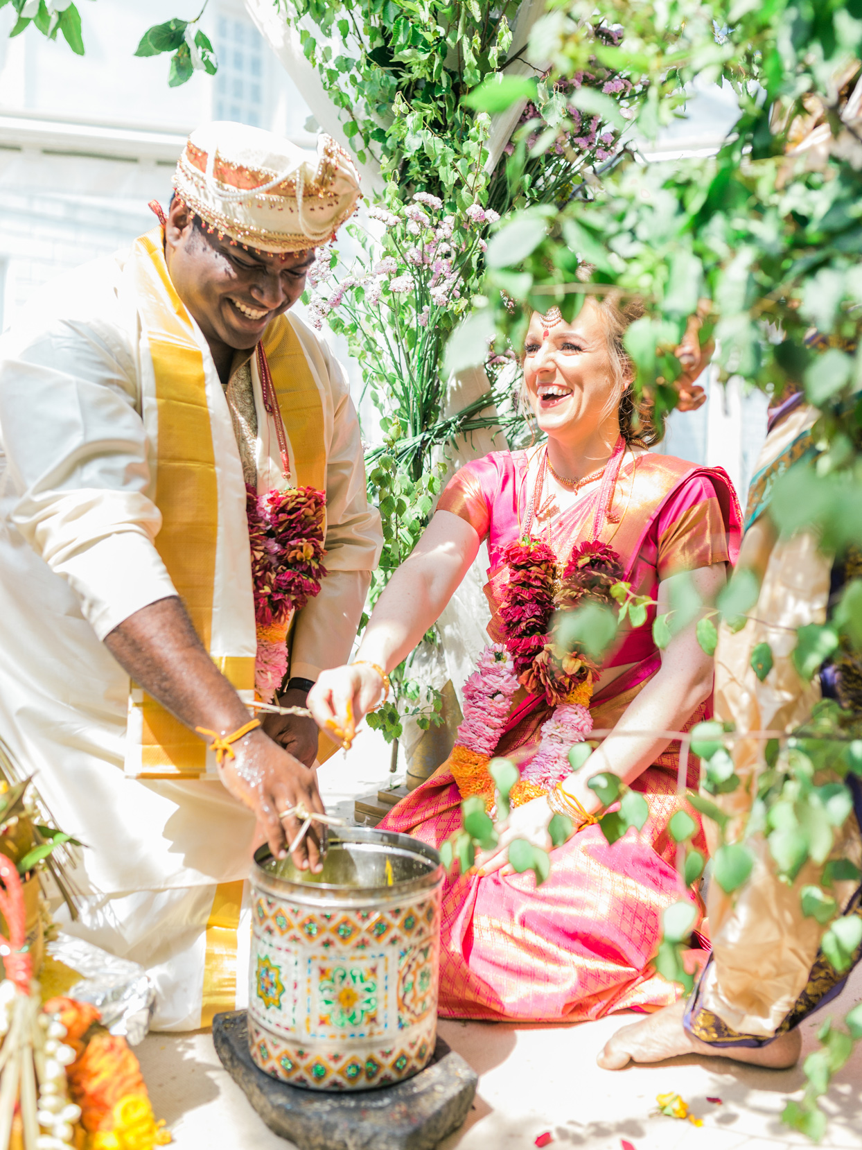 couple during traditional hindu sacred fire ritual