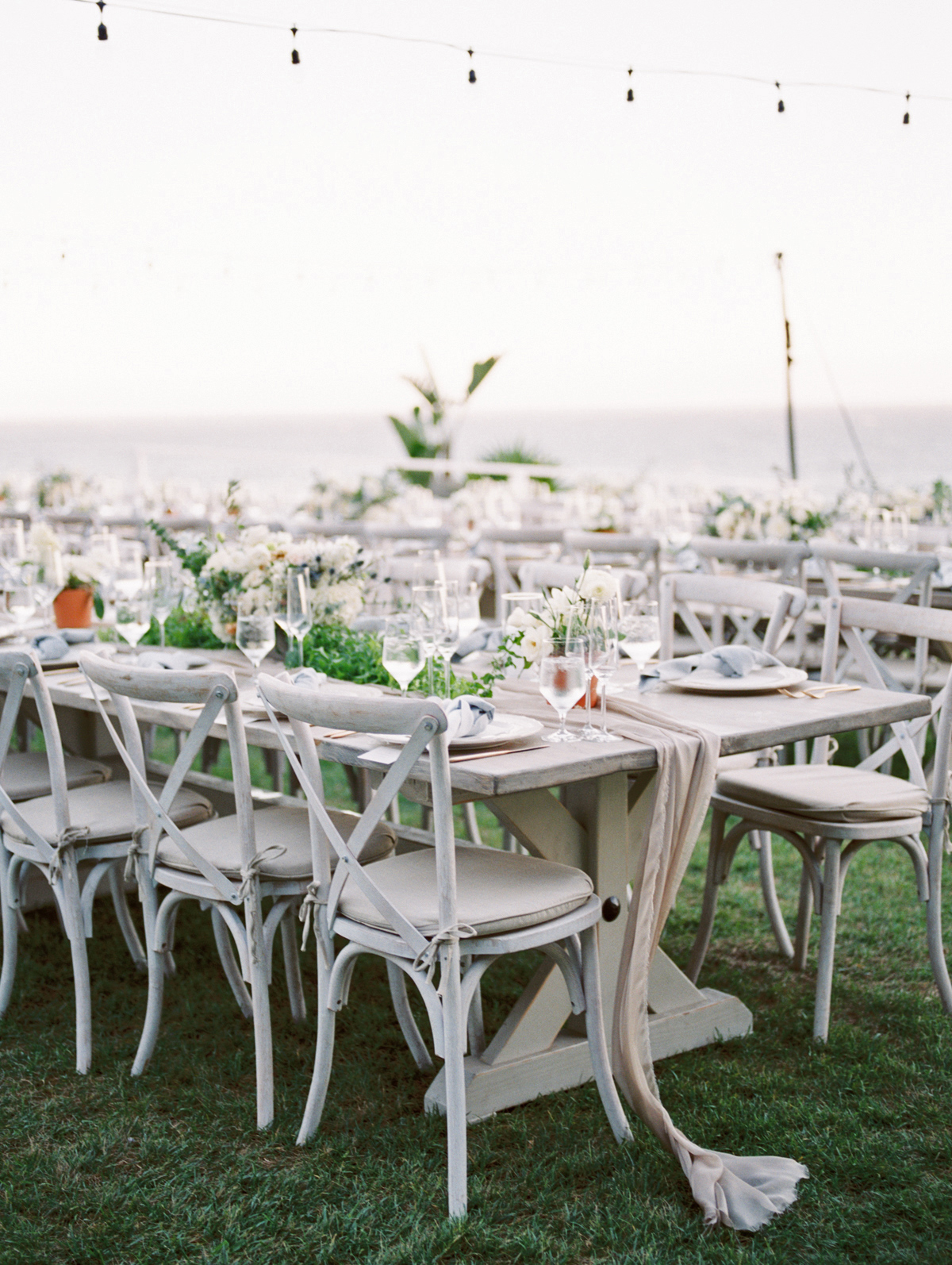 bettina gino wedding reception tables on grass