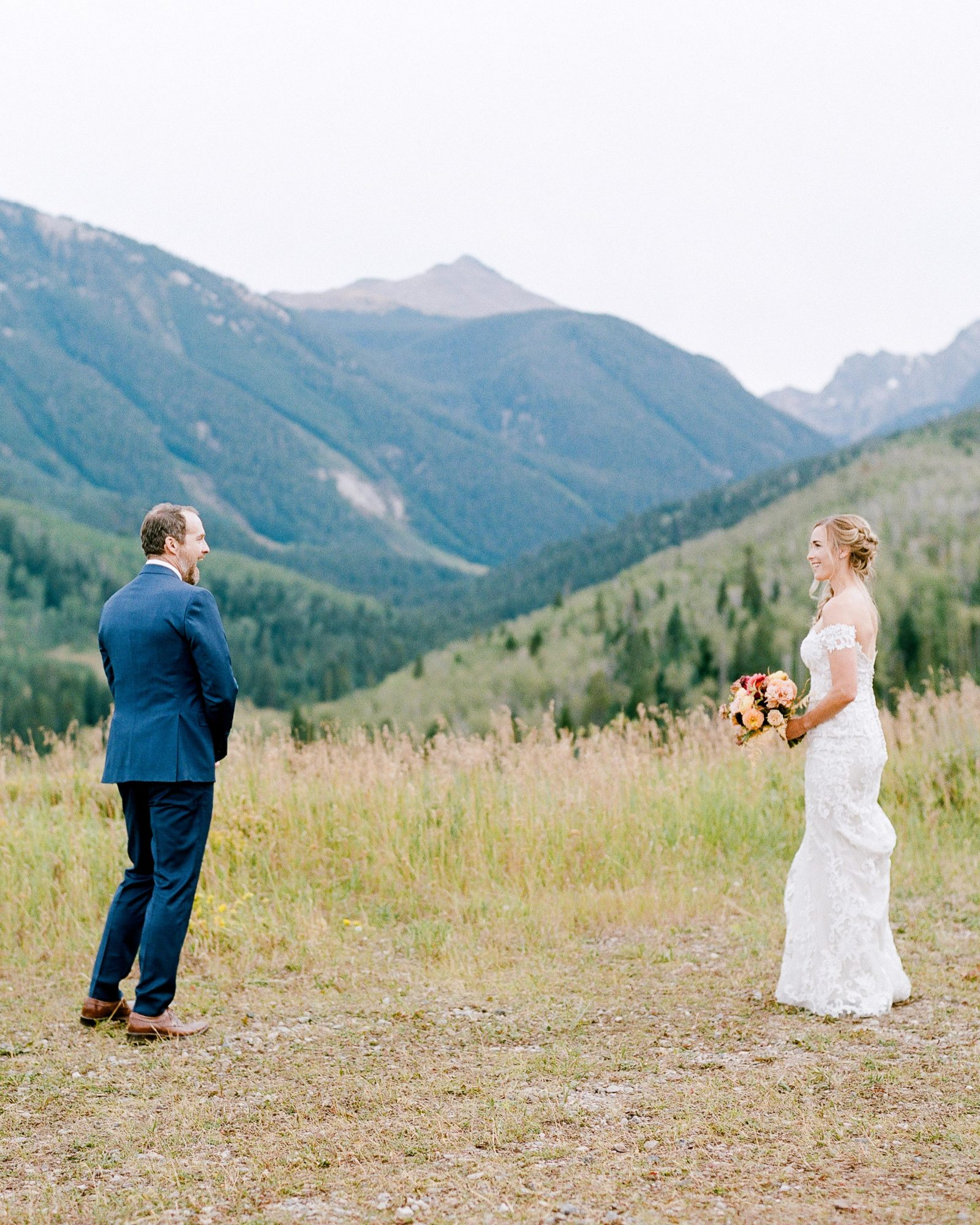 jill phil wedding couple first look surrounded by mountain view