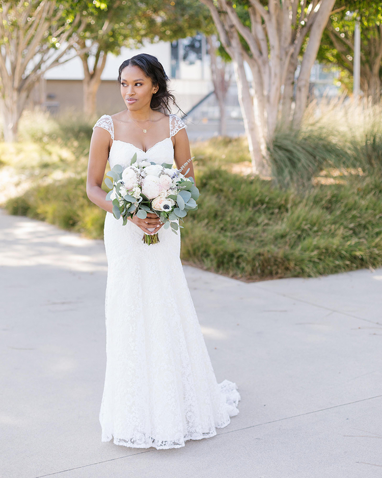 shelana kevin wedding bride in dress holding bouquet
