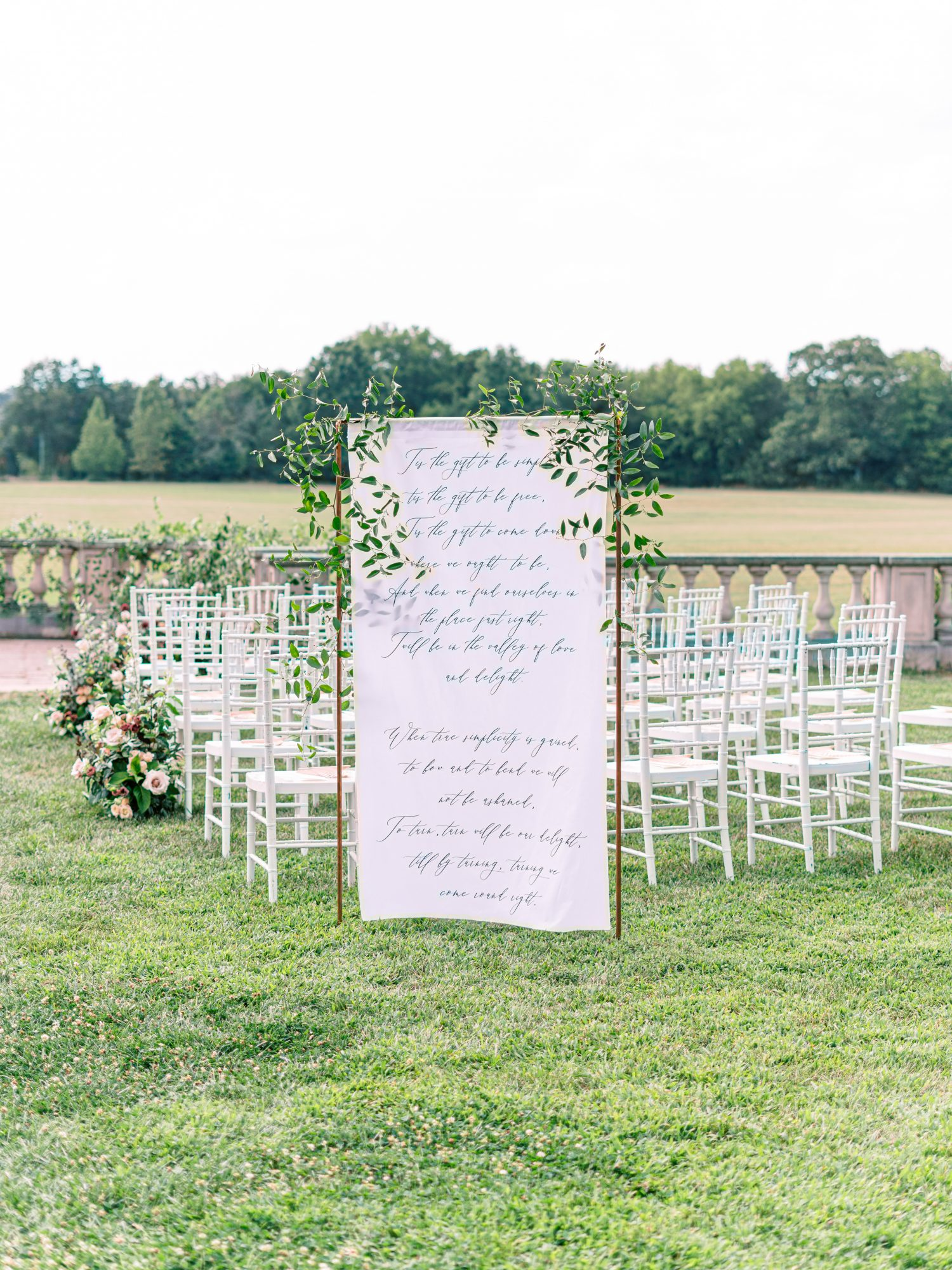 katelyn jose wedding ceremony sign with greenery detail