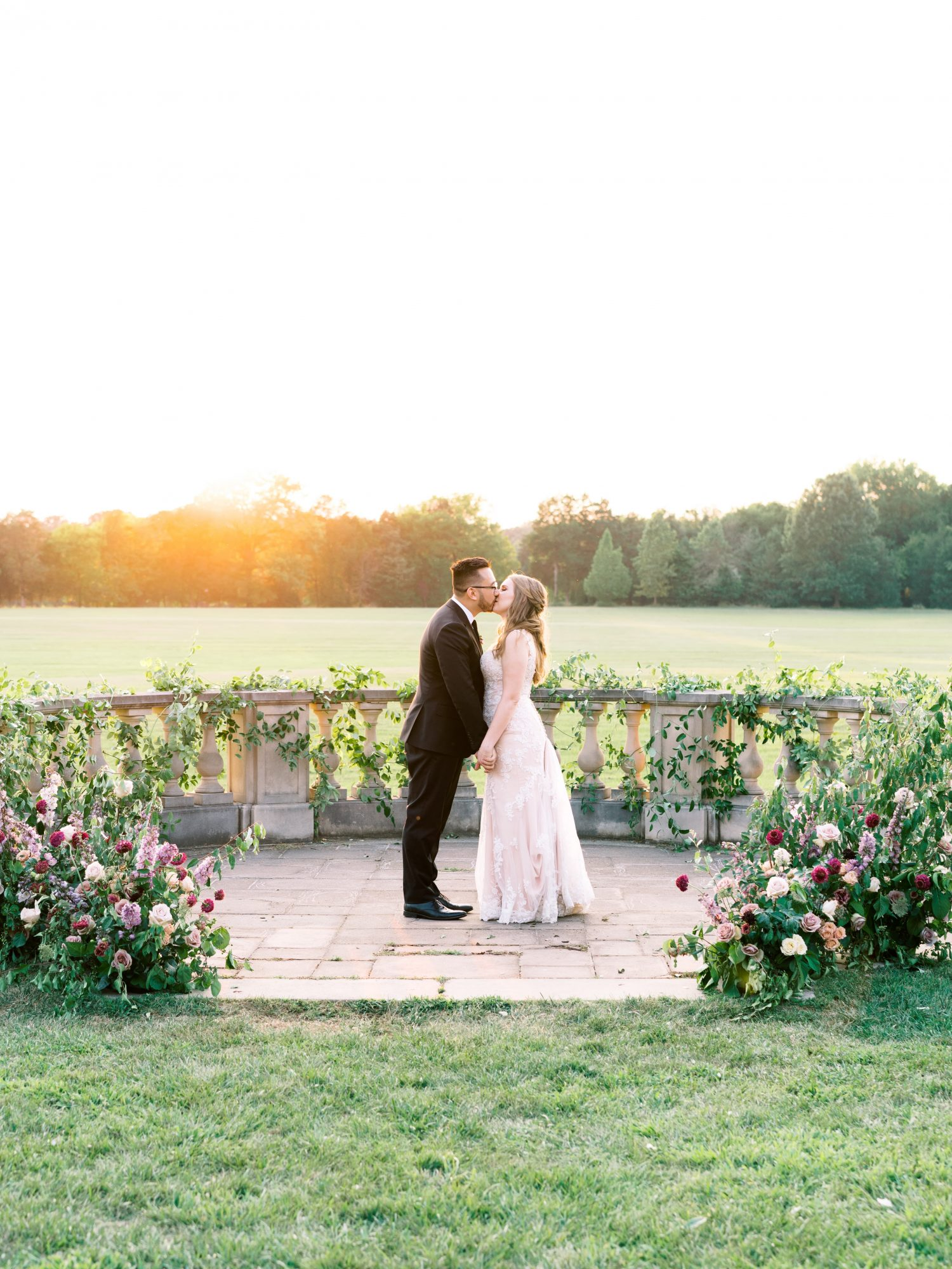 katelyn jose wedding couple kissing with sunset backdrop
