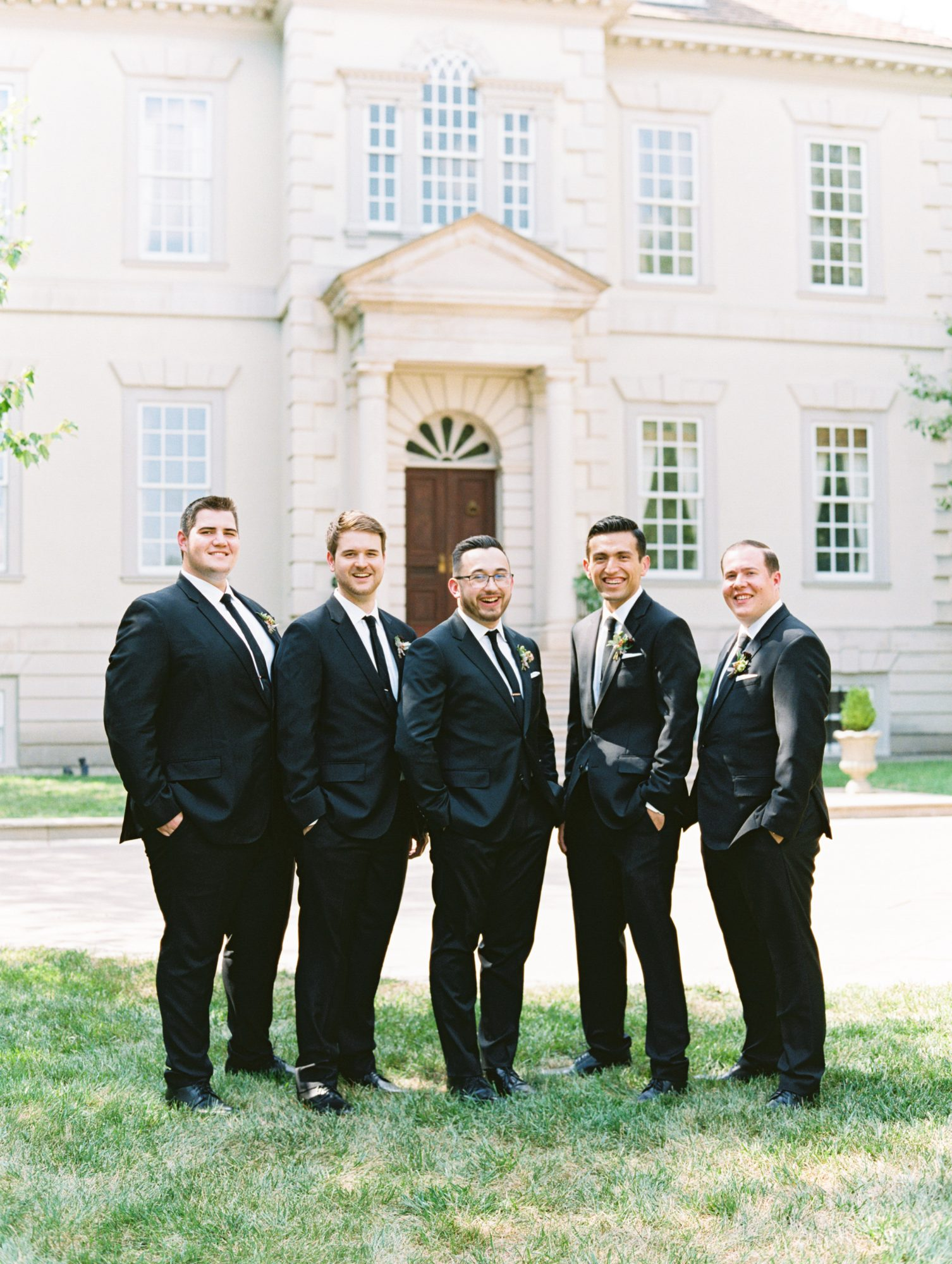 katelyn jose wedding groom and groomsmen posing in tuxedos
