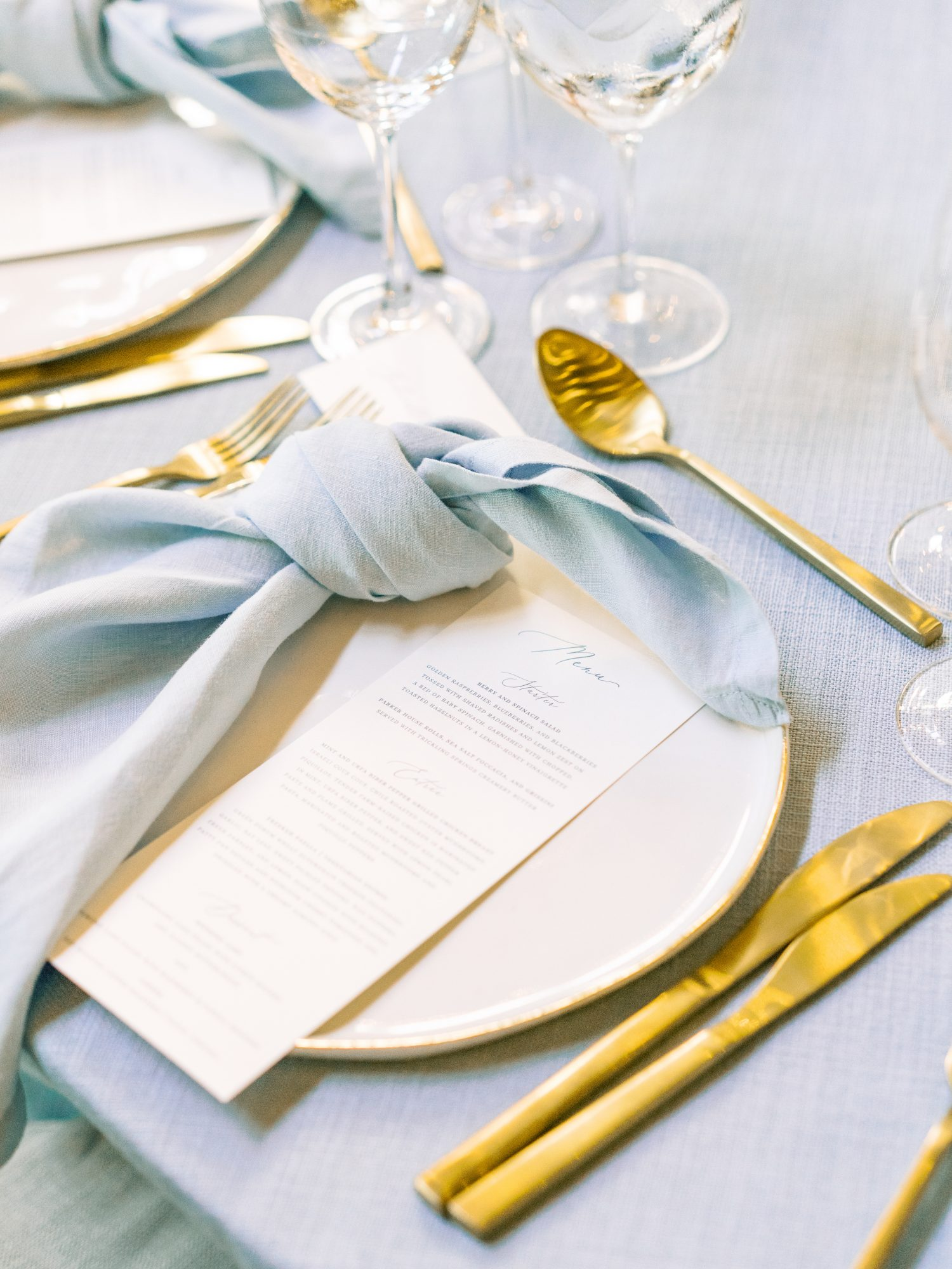 katelyn jose wedding menu with blue napkin