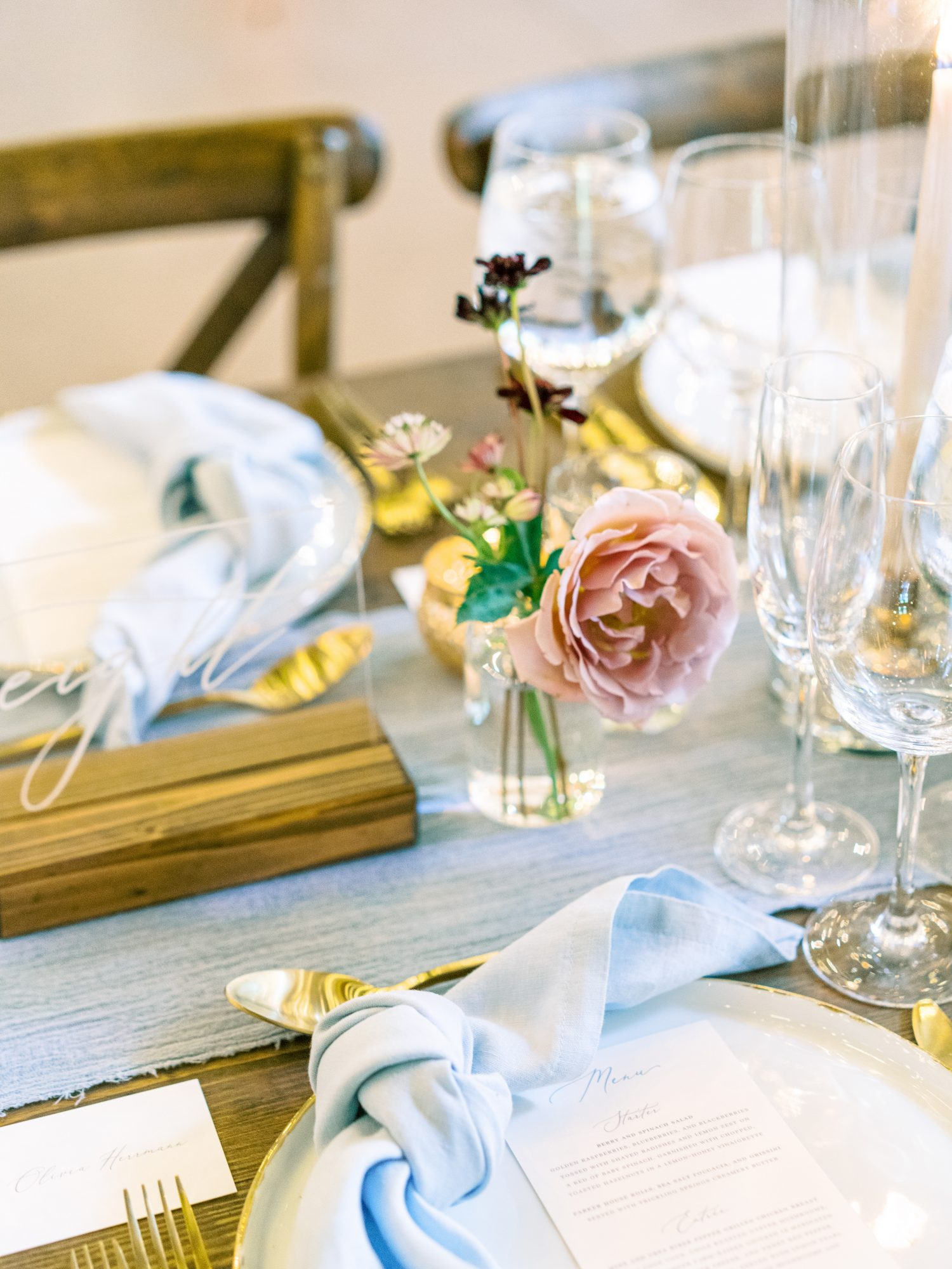 katelyn jose wedding place setting next to floral centerpiece