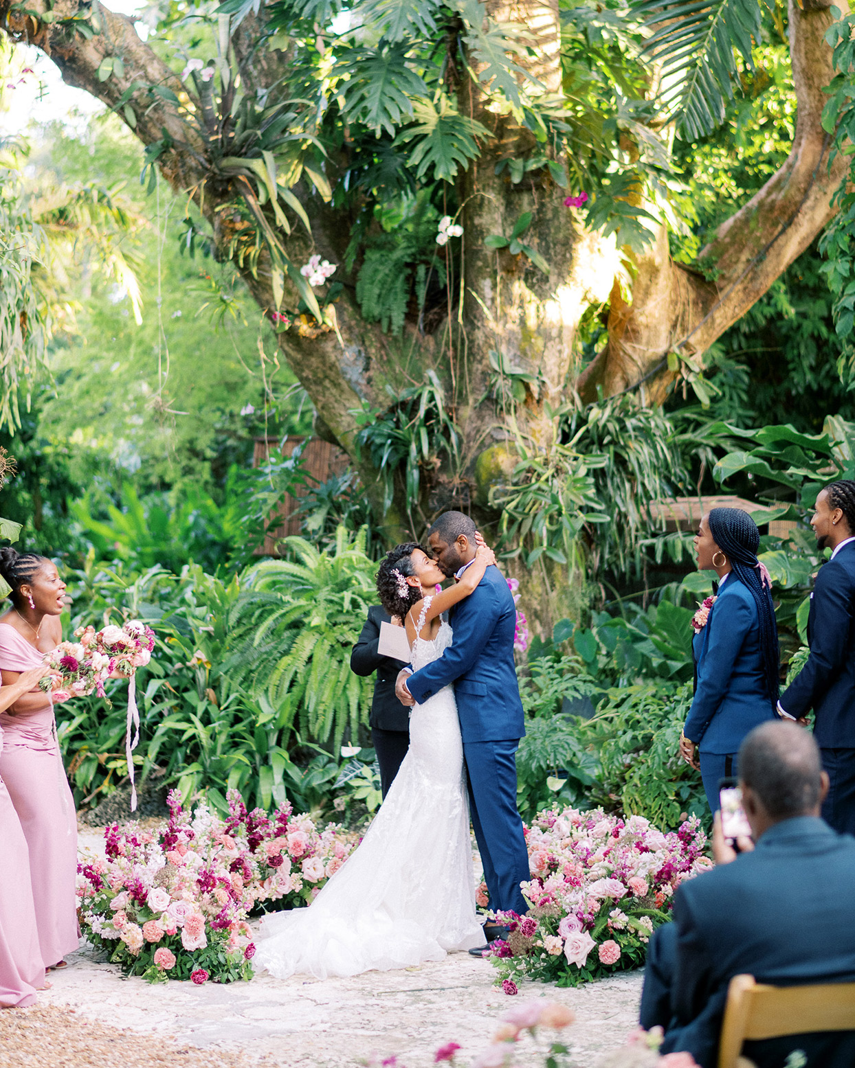 melissa lindsey wedding couple first kiss under tropical tree