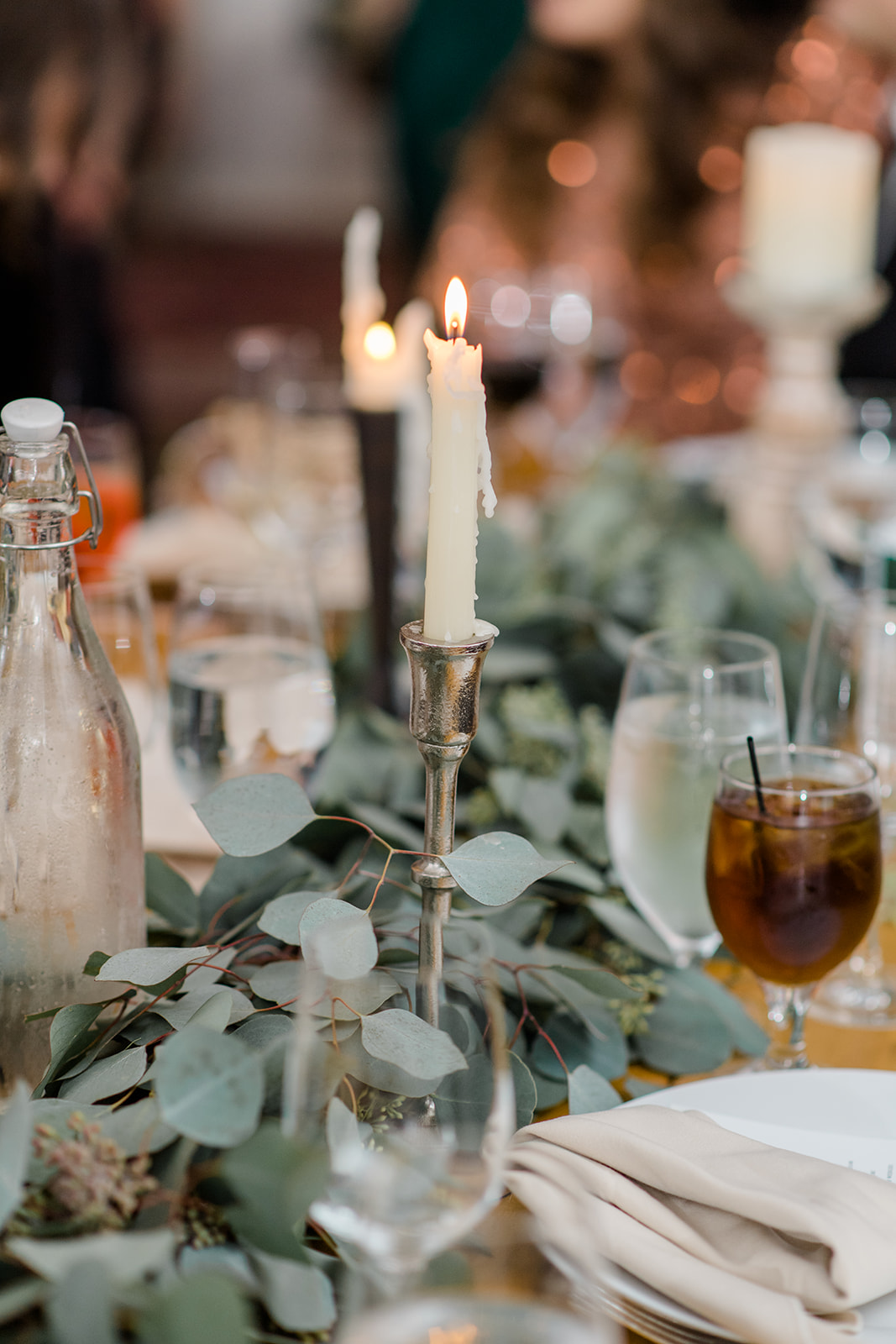 tall candles and greenery table decor